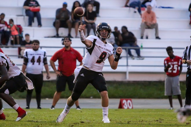 West Florida quarterback Trevor Jordan (9) passes the ball against the Aggies at Tate High School on Friday, August 31, 2018.
