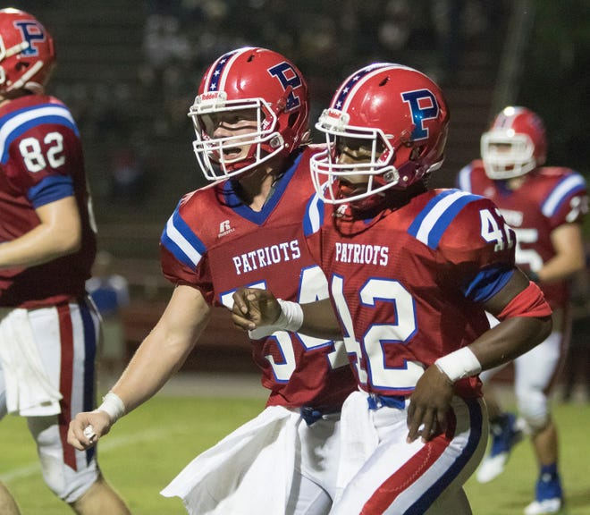 Hunter Watson (54) congratulates Tyler Hunter (42) after he scored touchdown increasing their lead to 30-22 during the PHS vs Pace football game at Pace High School in Pace on Friday, August 31, 2018.