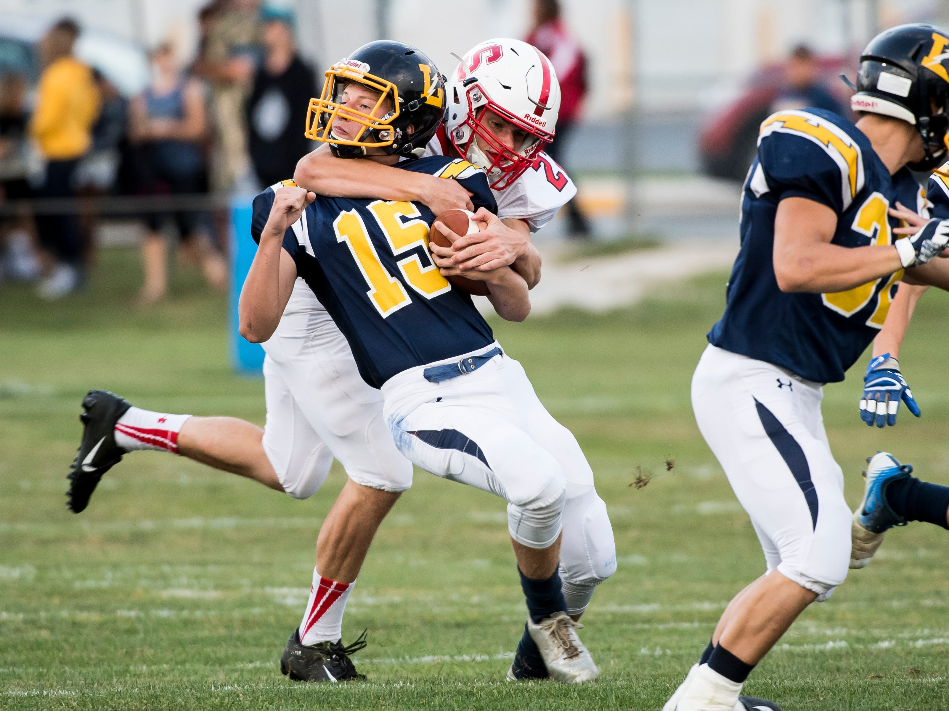 Littlestown's Timothy Huffman (15) is tackled by a Susquehannock player while returning the opening kickoff on Friday, August 31, 2018. The Bolts beat the Warriors 29-14.