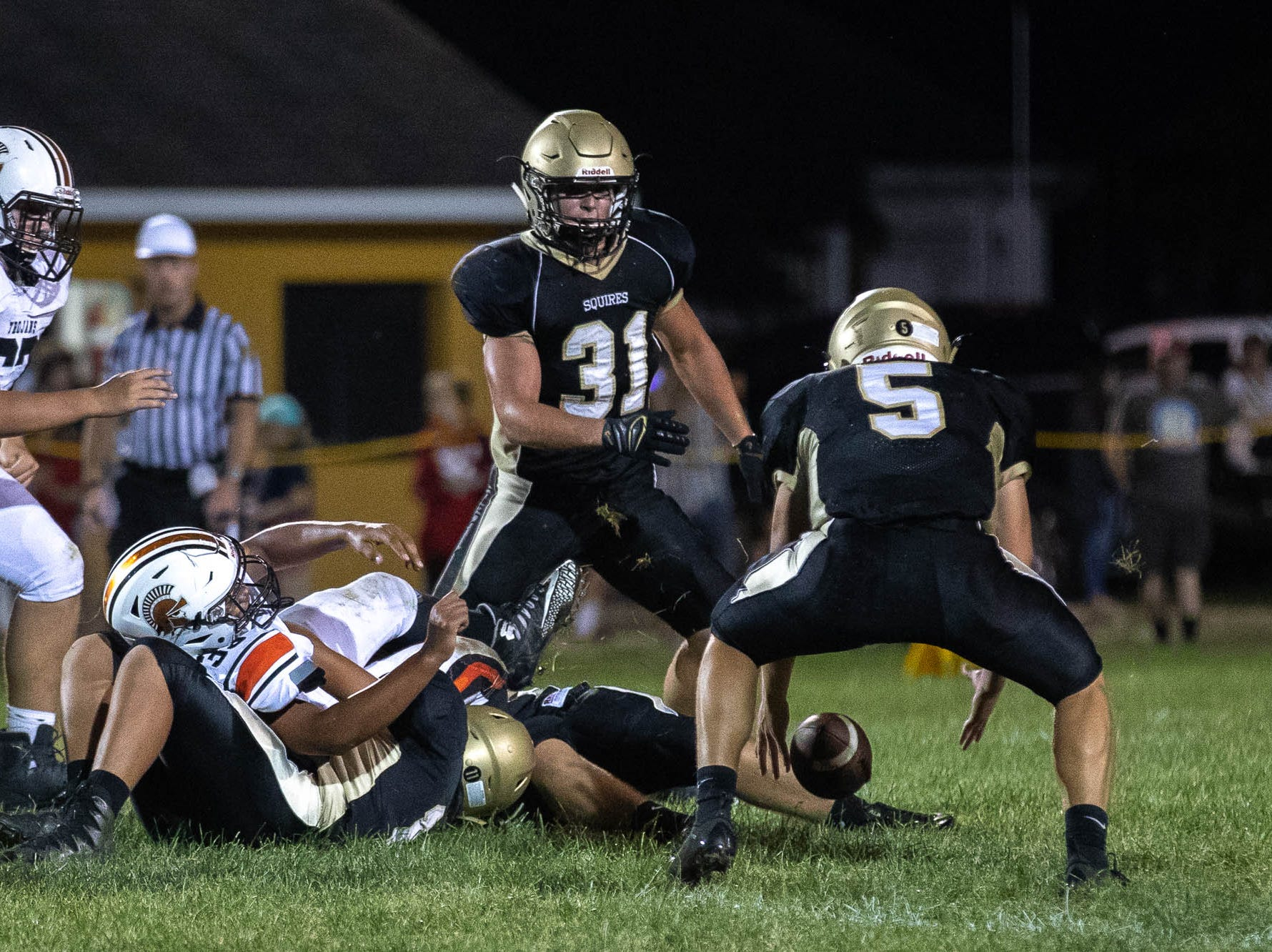 Delone's Kevin Mowrey (5) retrieves a fumble before scoring a 53-yard touchdown during the second half of a football game between Delone Catholic and York Suburban, Friday, Aug. 31, 2018, at Delone Catholic High School in McSherrystown. Delone beat York Suburban 62-0.