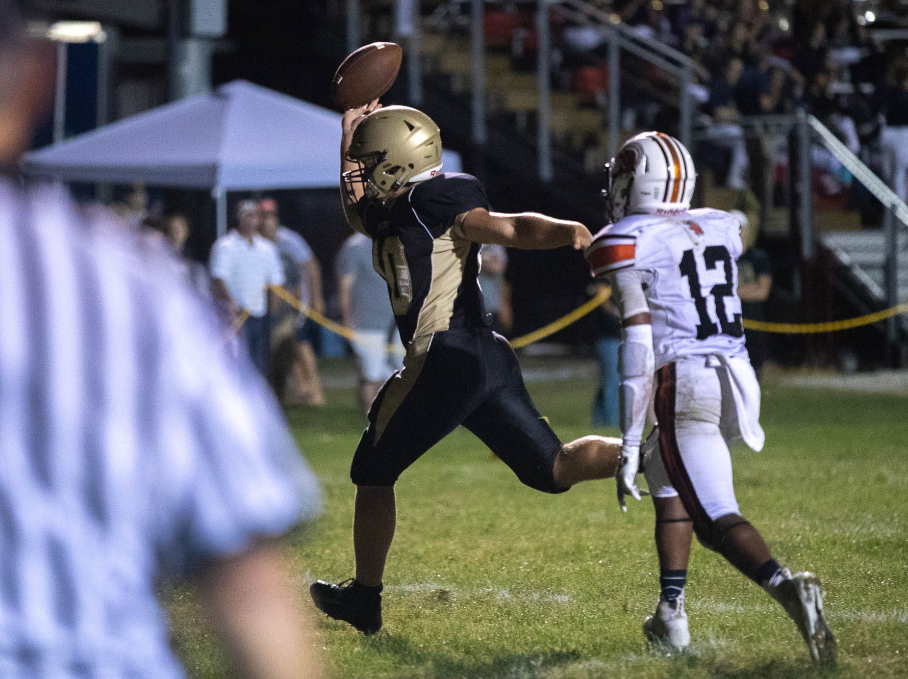 Delone's Josh Fulton (40) scores a touchdown during the second half of a football game between Delone Catholic and York Suburban, Friday, Aug. 31, 2018, at Delone Catholic High School in McSherrystown. Delone beat York Suburban 62-0.