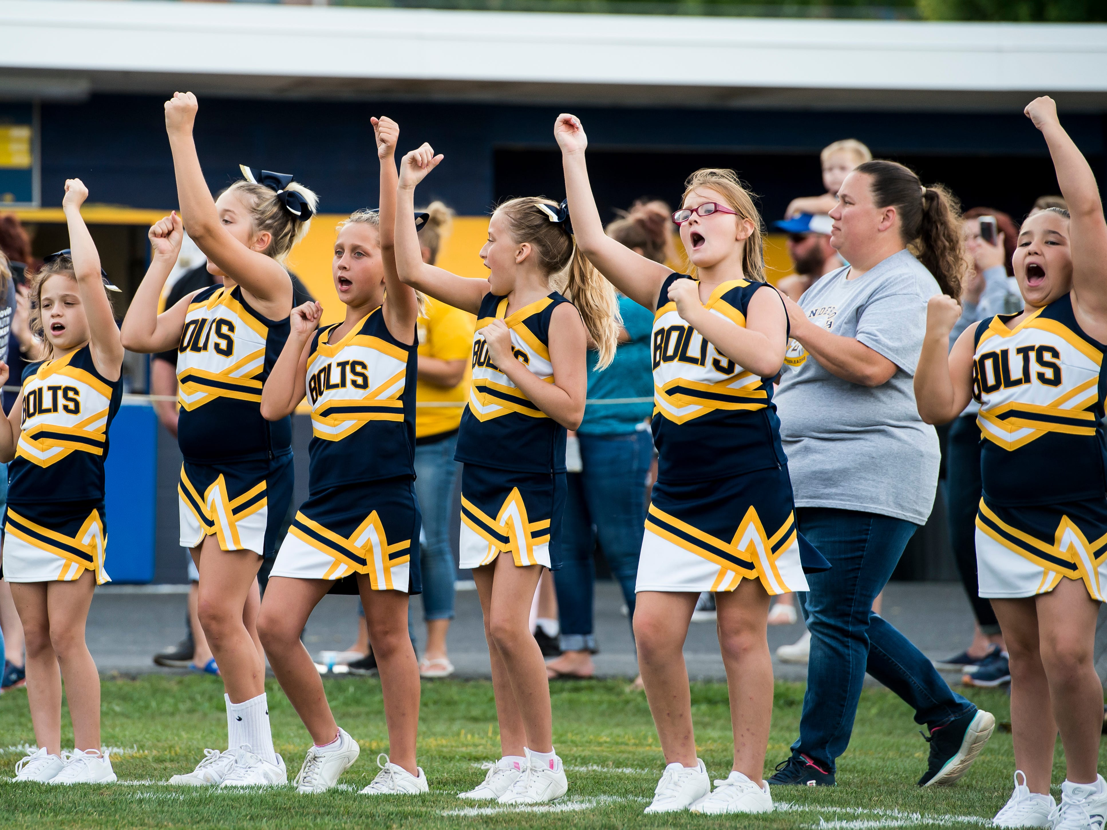 Littlestown cheerleaders make some noise for the Bolts before a game against Susquehannock on Friday, August 31, 2018. The Bolts beat the Warriors 29-14.