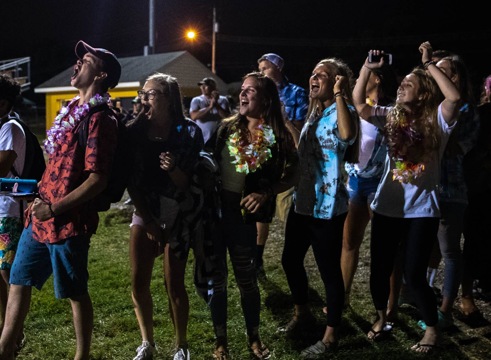 The Delone student section cheers for their team as Delone players walk to the locker room after winning a game against York Suburban, Friday, Aug. 31, 2018, at Delone Catholic High School in McSherrystown. Delone beat York Suburban 62-0.