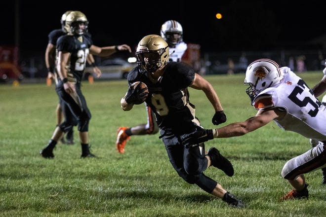 Delone's Logan Brown (9) scores a touchdown during the second half of a football game between Delone Catholic and York Suburban, Friday, Aug. 31, 2018, at Delone Catholic High School in McSherrystown. Delone beat York Suburban 62-0.