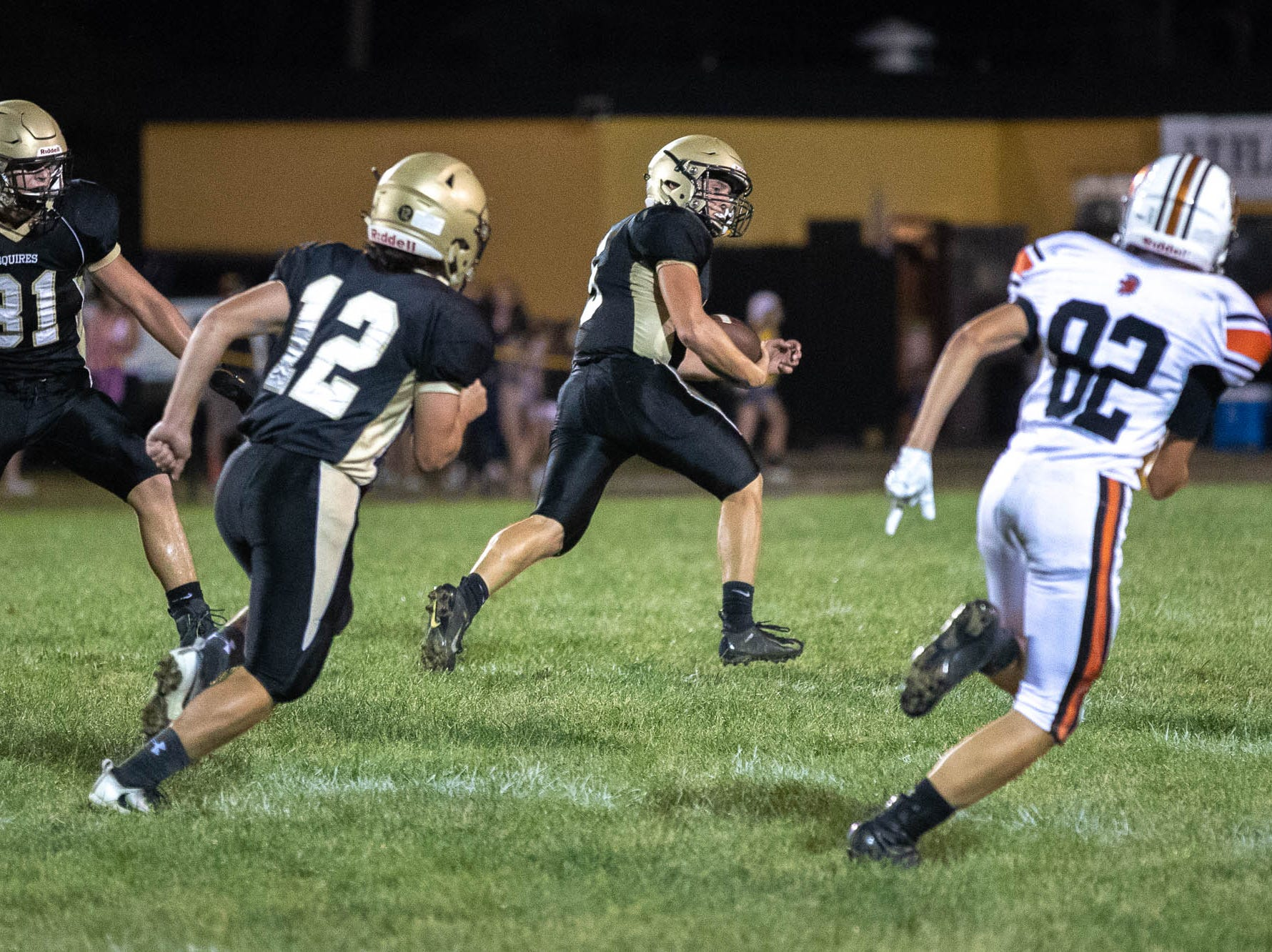 Delone's Kevin Mowrey (5) races with a fumble before scoring a 53-yard touchdown during the second half of a football game between Delone Catholic and York Suburban, Friday, Aug. 31, 2018, at Delone Catholic High School in McSherrystown. Delone beat York Suburban 62-0.