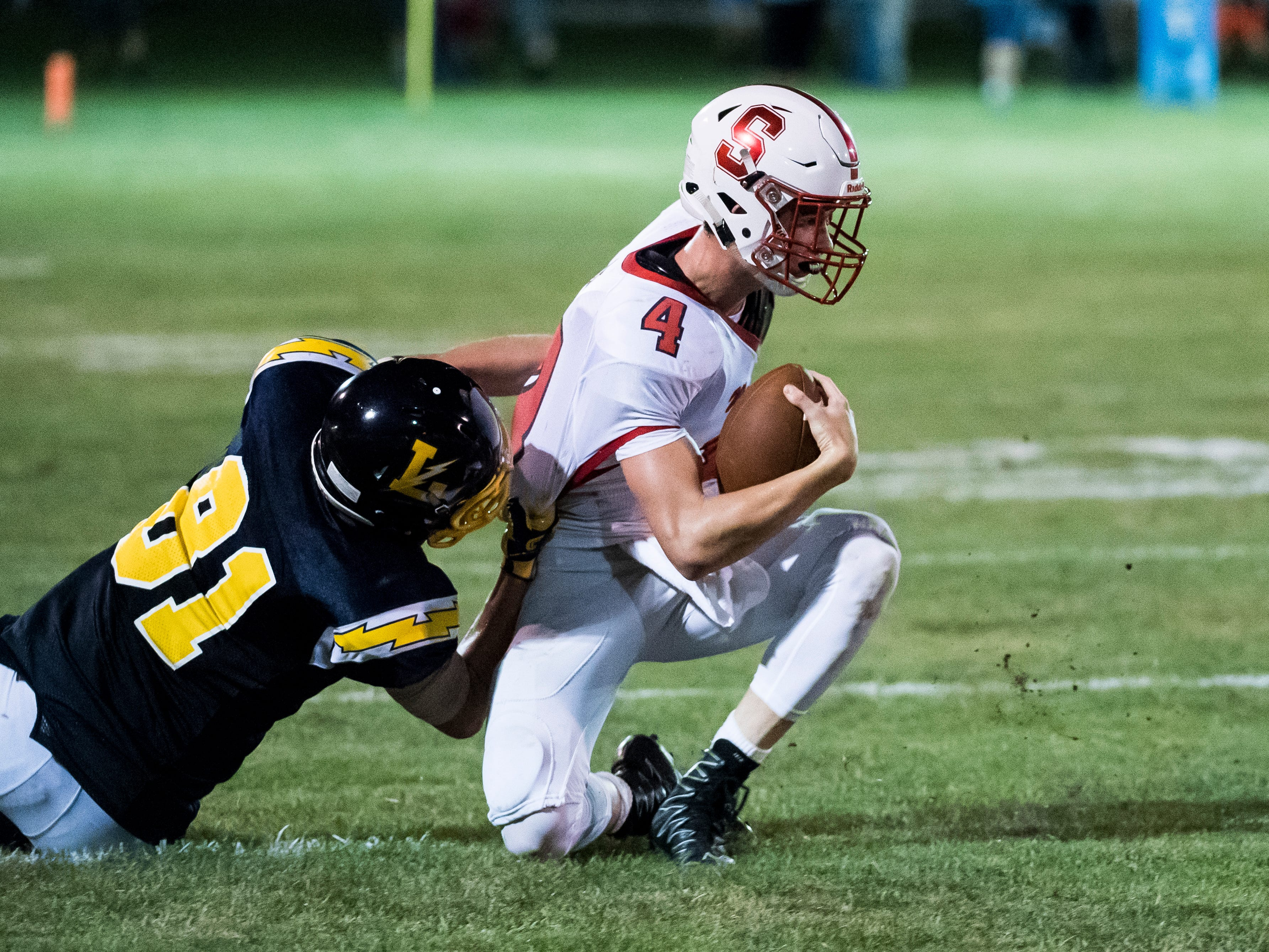 Susquehannock quarterback Kenny Rhyne is brought down by Brady McClintock on Friday, August 31, 2018. The Bolts beat the Warriors 29-14.