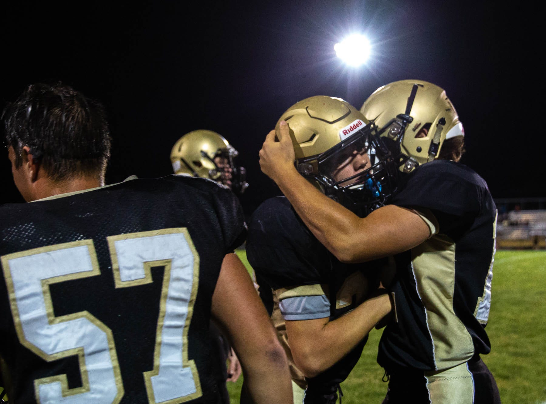 Delone's Tate Neiderer (24) is embraced by Delone's Sam Meighan (12) after Neiderer scored a touchdown during the second half of a football game between Delone Catholic and York Suburban, Friday, Aug. 31, 2018, at Delone Catholic High School in McSherrystown. Delone beat York Suburban 62-0.
