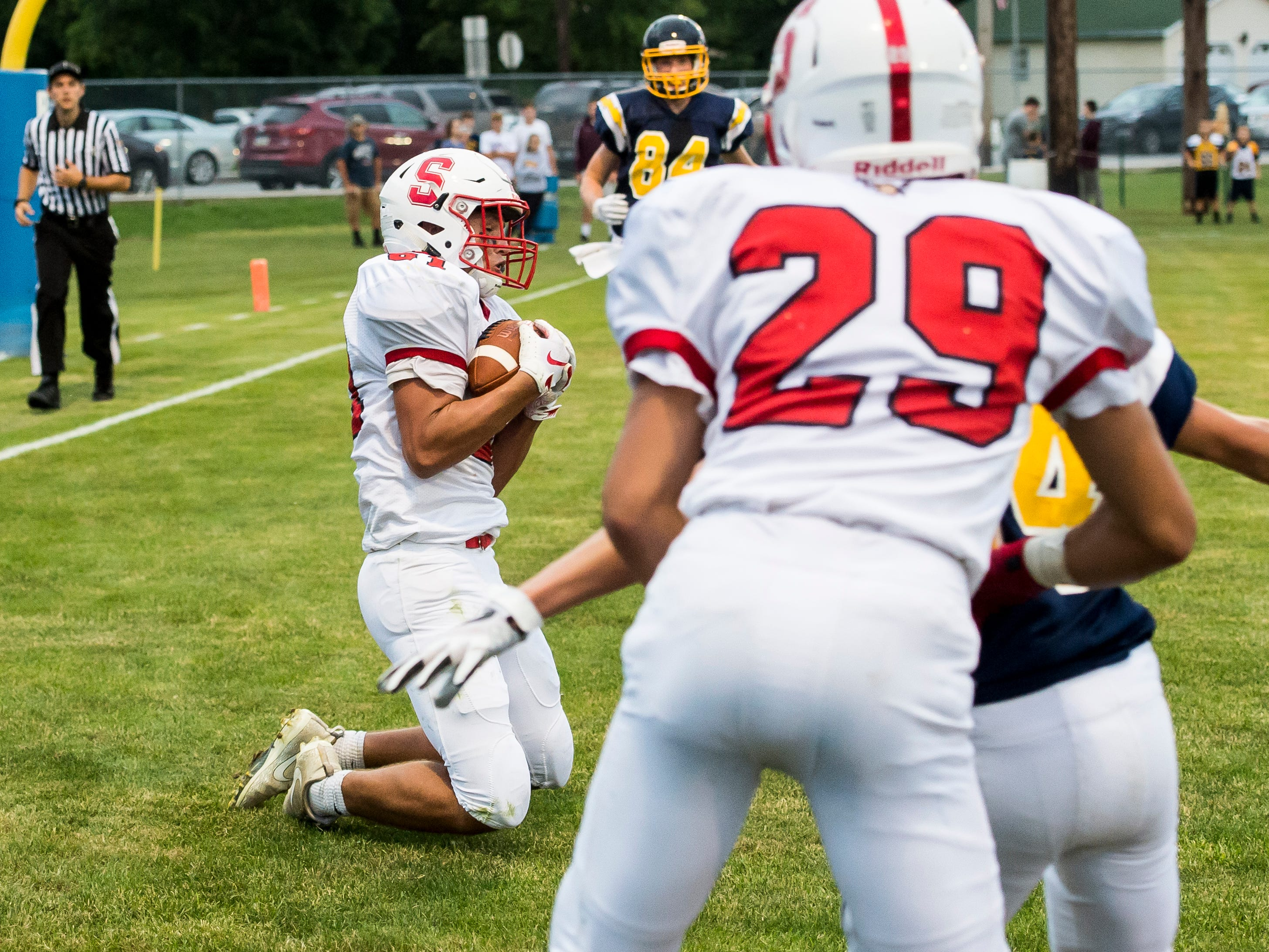 Susquehannock's Zach Green holds onto a pass to score a touchdown against Littlestown on Friday, August 31, 2018. The Warriors fell to the Bolts 29-14.