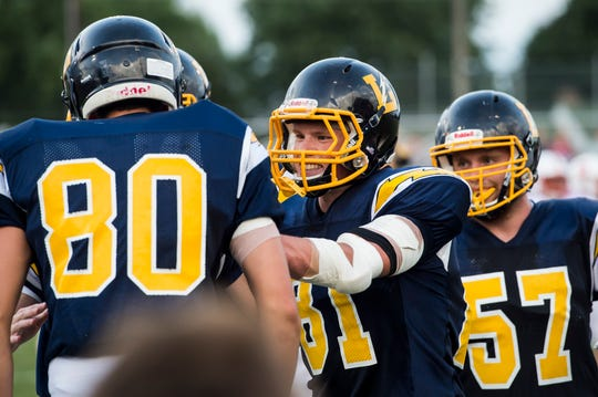 Littlestown's Brady McClintock (81) celebrates with Jacob Thomas  (80) after Thomas scored a touchdown against Susquehannock on Friday, August 31, 2018. The Bolts beat the Warriors 29-14.