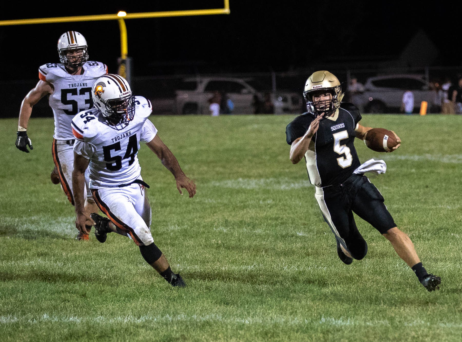 Delone's Kevin Mowrey (5) runs the ball during the second half of a football game between Delone Catholic and York Suburban, Friday, Aug. 31, 2018, at Delone Catholic High School in McSherrystown. Delone beat York Suburban 62-0.