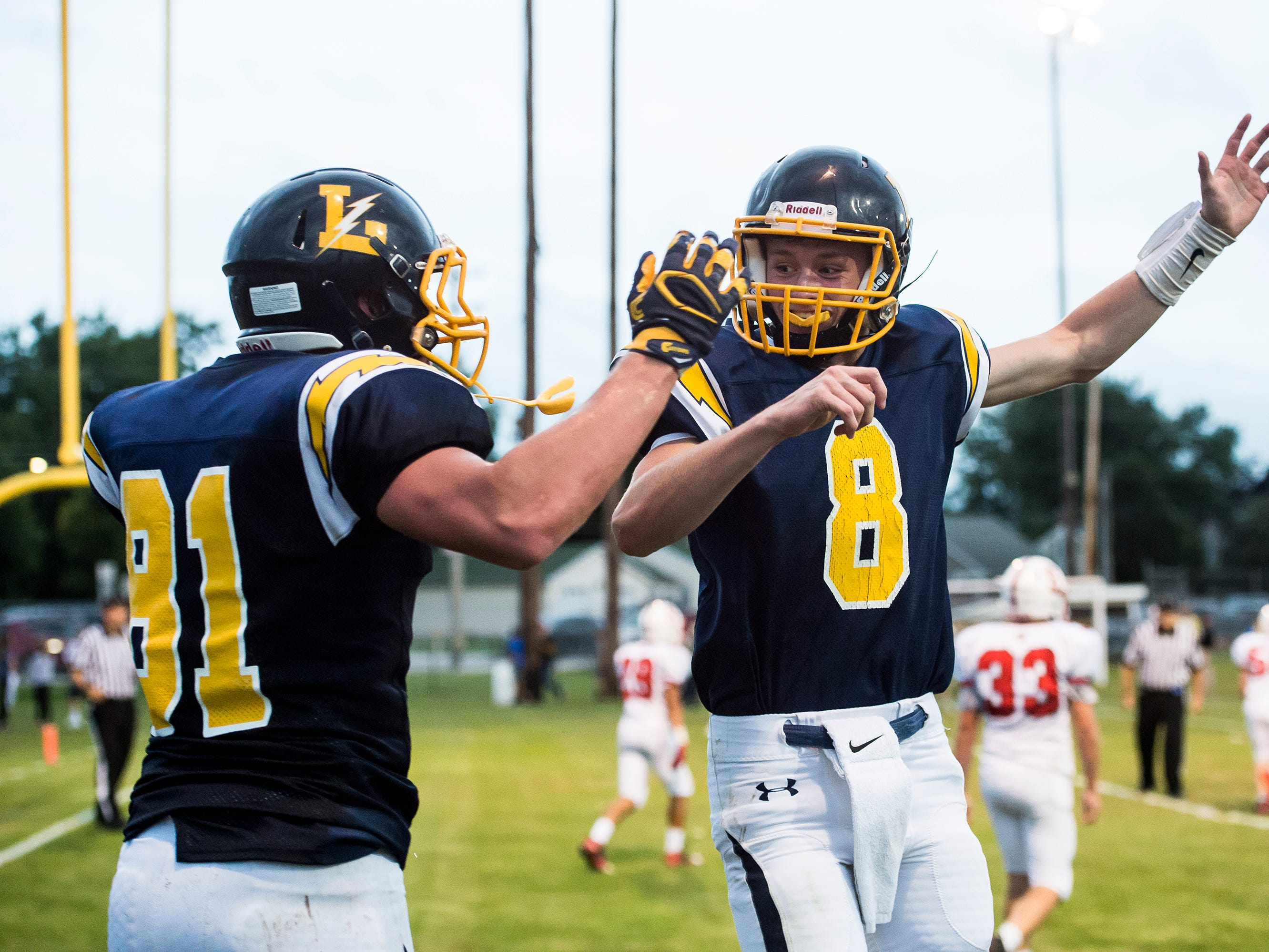 Littlestown quarterback Jakob Lane (8) celebrates with tight end Brady McClintock after the pair connected for a touchdown against Susquehannock on Friday, August 31, 2018. The Bolts beat the Warriors 29-14.