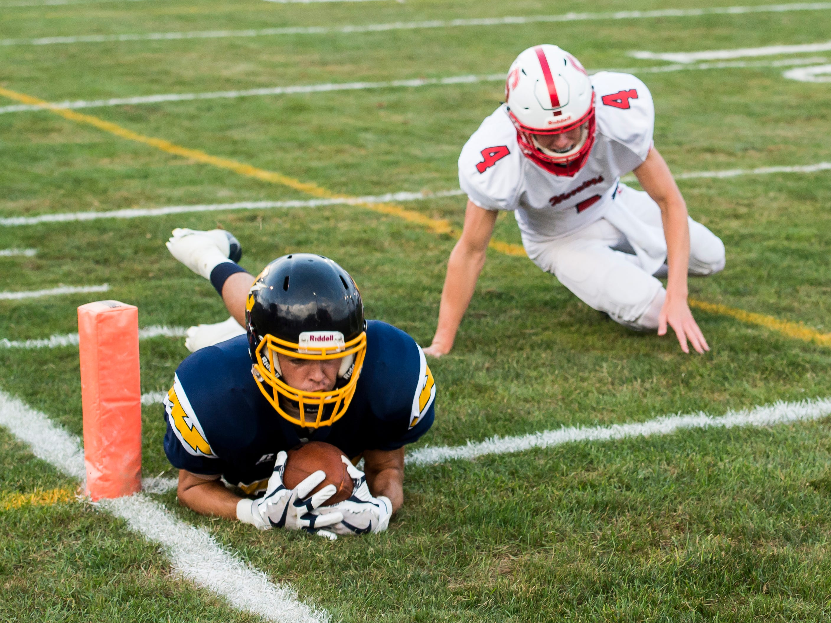 Littlestown's Jacob Thomas dives into the end zone to score a touchdown against Susquehannock on Friday, August 31, 2018. The Bolts beat the Warriors 29-14.