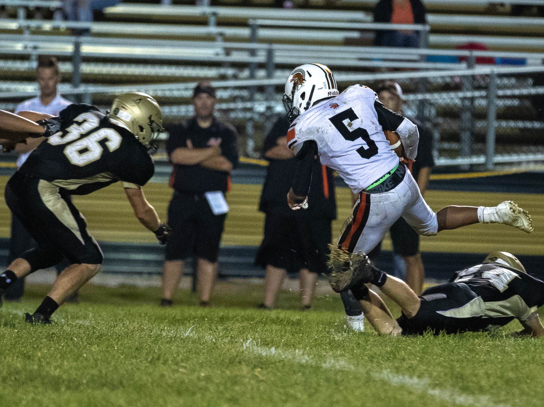 York Suburban's Donald Dent (5) dodges Delone's Tate Neiderer (24) during the second half of a football game between Delone Catholic and York Suburban, Friday, Aug. 31, 2018, at Delone Catholic High School in McSherrystown. Delone beat York Suburban 62-0.