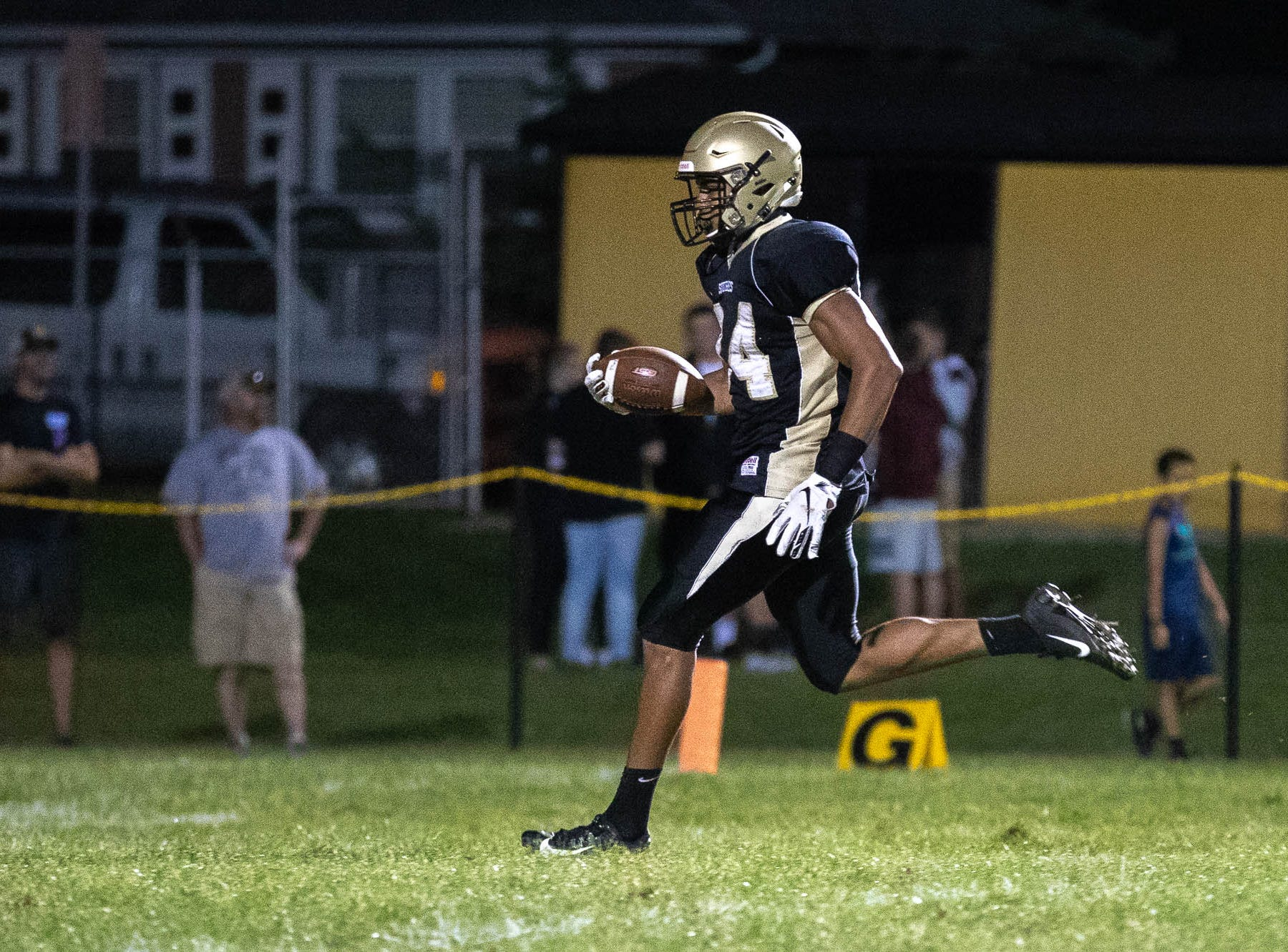 Delone's Marquis Suite (84) scores a touchdown during the second half of a football game between Delone Catholic and York Suburban, Friday, Aug. 31, 2018, at Delone Catholic High School in McSherrystown. Delone beat York Suburban 62-0.