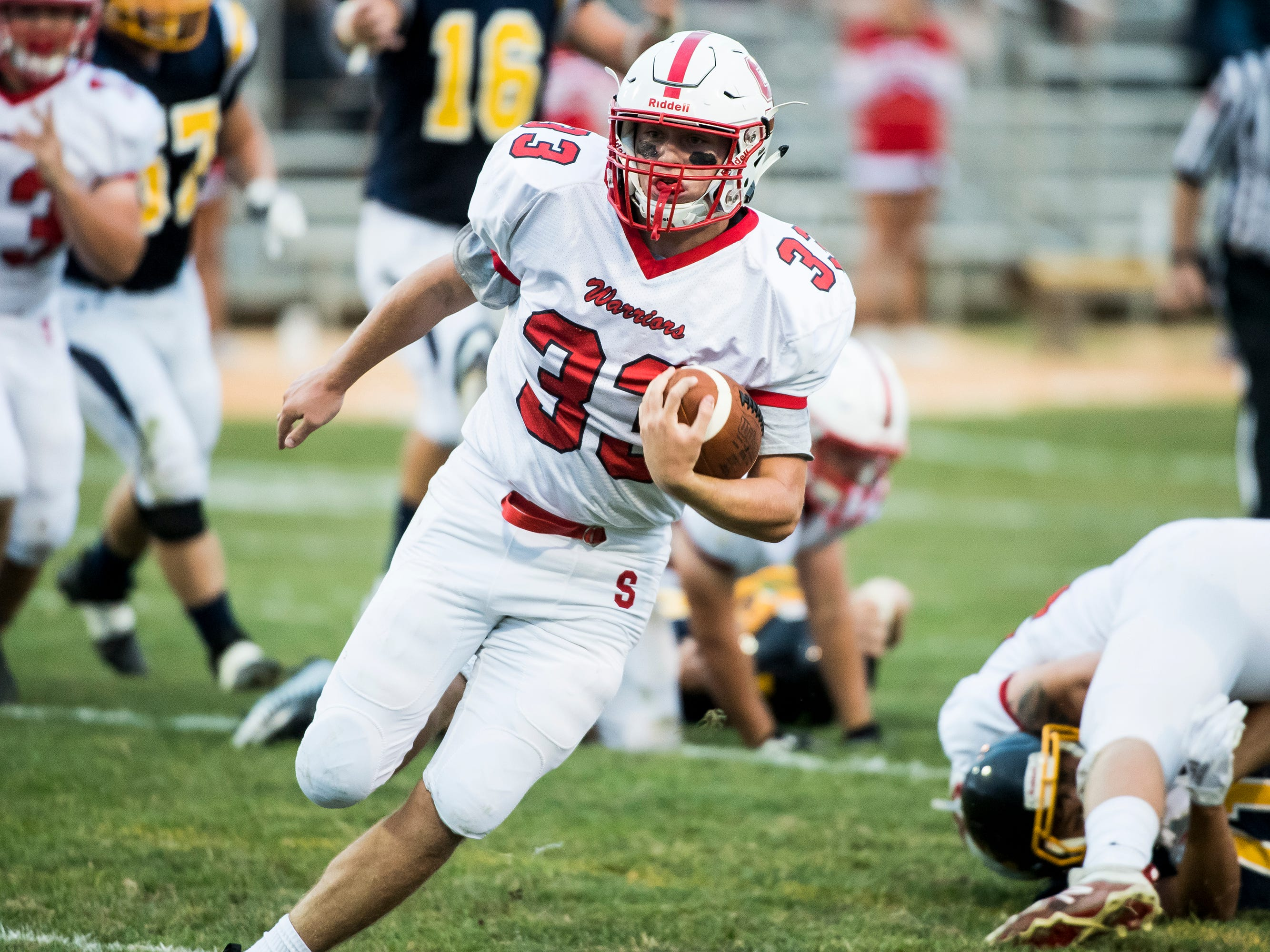 Susquehannock's Allen Clapp runs with the ball against Littlestown on Friday, August 31, 2018. The Bolts beat the Warriors 29-14.