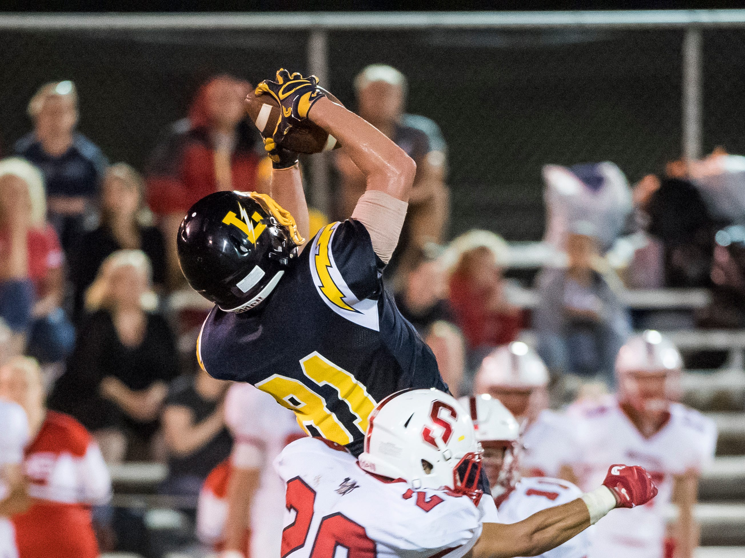 Littlestown's Brady McClintock jumps up to catch a pass from Jakob Lane during play against Susquehannock on Friday, August 31, 2018. The Bolts beat the Warriors 29-14.
