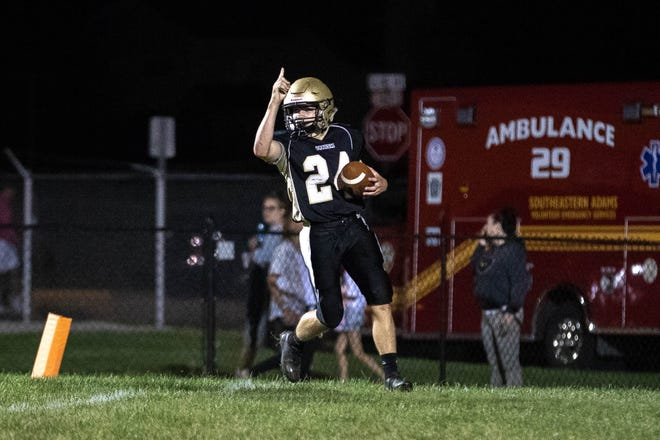 Delone's Tate Neiderer (24) celebrates after he scored a touchdown during the second half of a football game between Delone Catholic and York Suburban, Friday, Aug. 31, 2018, at Delone Catholic High School in McSherrystown. Delone beat York Suburban 62-0.