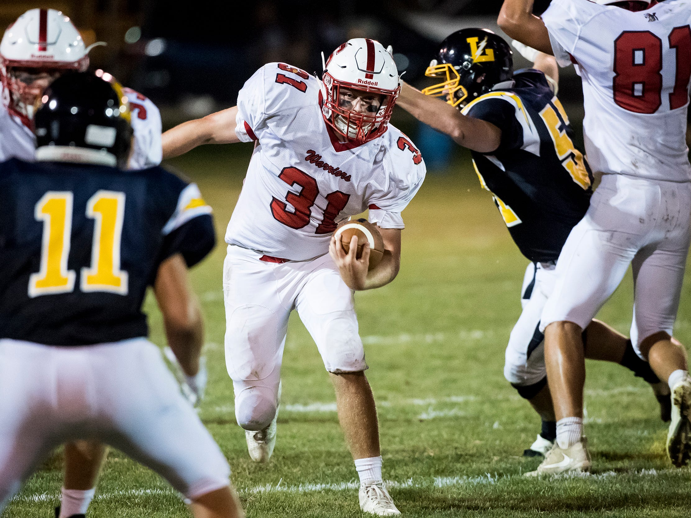 Susquehannock Allen Clapp carries the ball against Littlestown on Friday, August 31, 2018. The Bolts beat the Warriors 29-14.