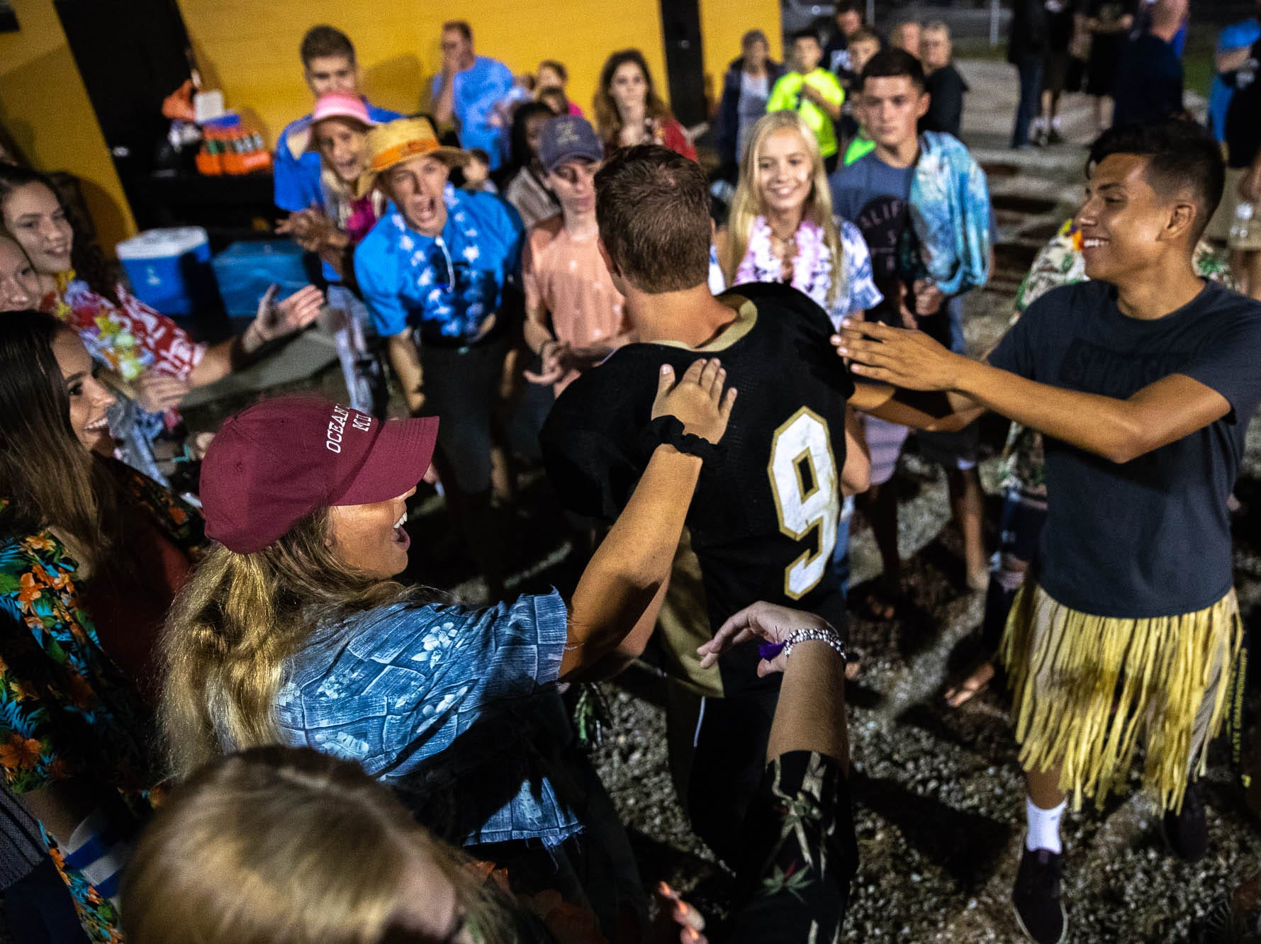 Members of the Delone student section cheer on Delone's Logan Brown (9) after winning a game against York Suburban, Friday, Aug. 31, 2018, at Delone Catholic High School in McSherrystown. Delone beat York Suburban 62-0.