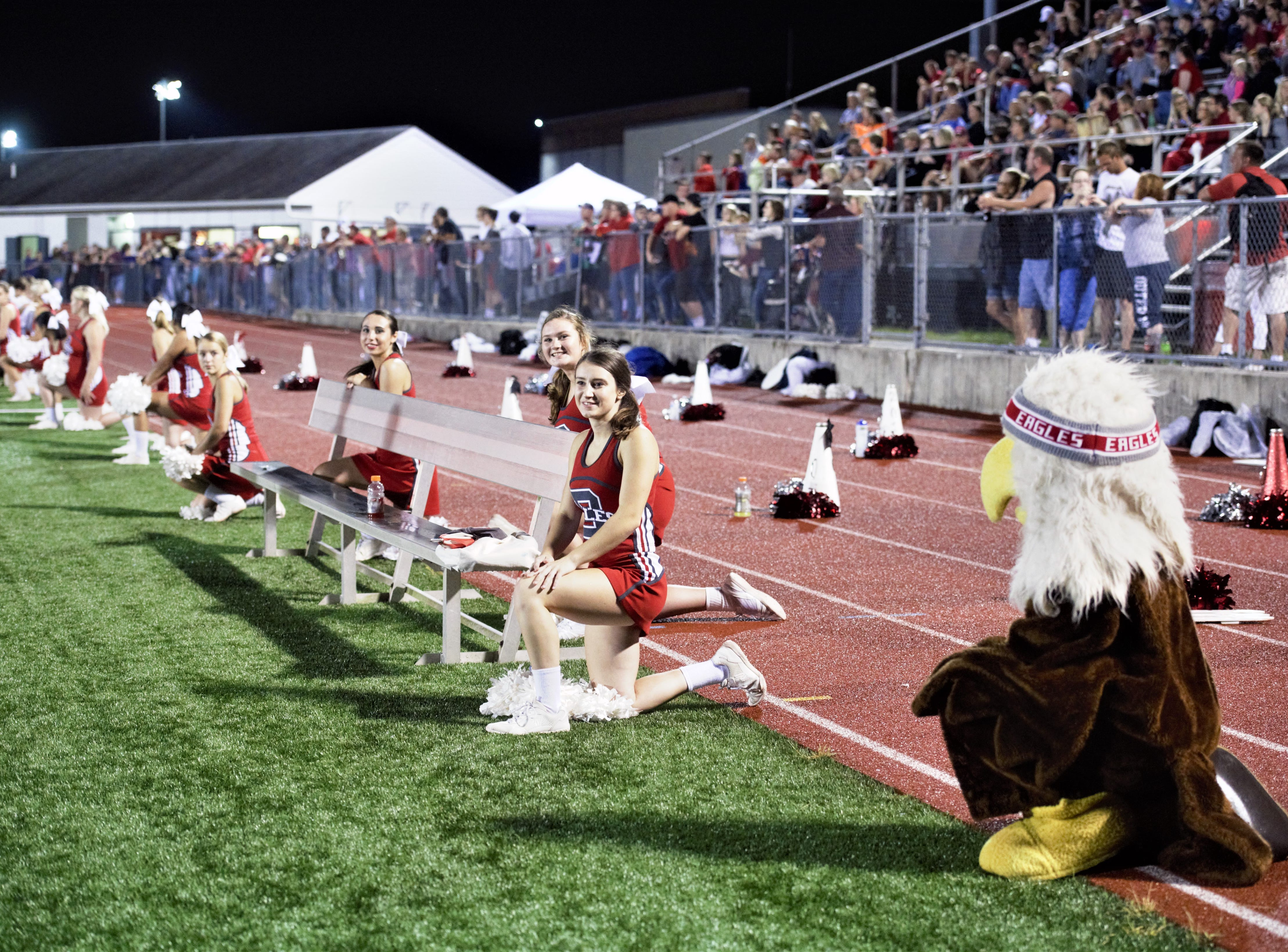 Bermudian Springs cheerleaders and mascot take a knee for an injured player on the field on Aug. 31, 2018. The Eagles came out on top in their home game against the Bubblers, 27-12.