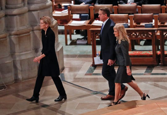 From l-r., Sen. Elizabeth Warren, D-Mass., Sen. Jeff Flake, R-Ariz., and his wife Cheryl Flake, arrive with other dignitaries and invited guests to attend a memorial service for Sen. John McCain, R-Ariz., at Washington National Cathedral in Washington, Saturday, Sept. 1, 2018. McCain died Aug. 25, from brain cancer at age 81. (AP Photo/Pablo Martinez Monsivais)