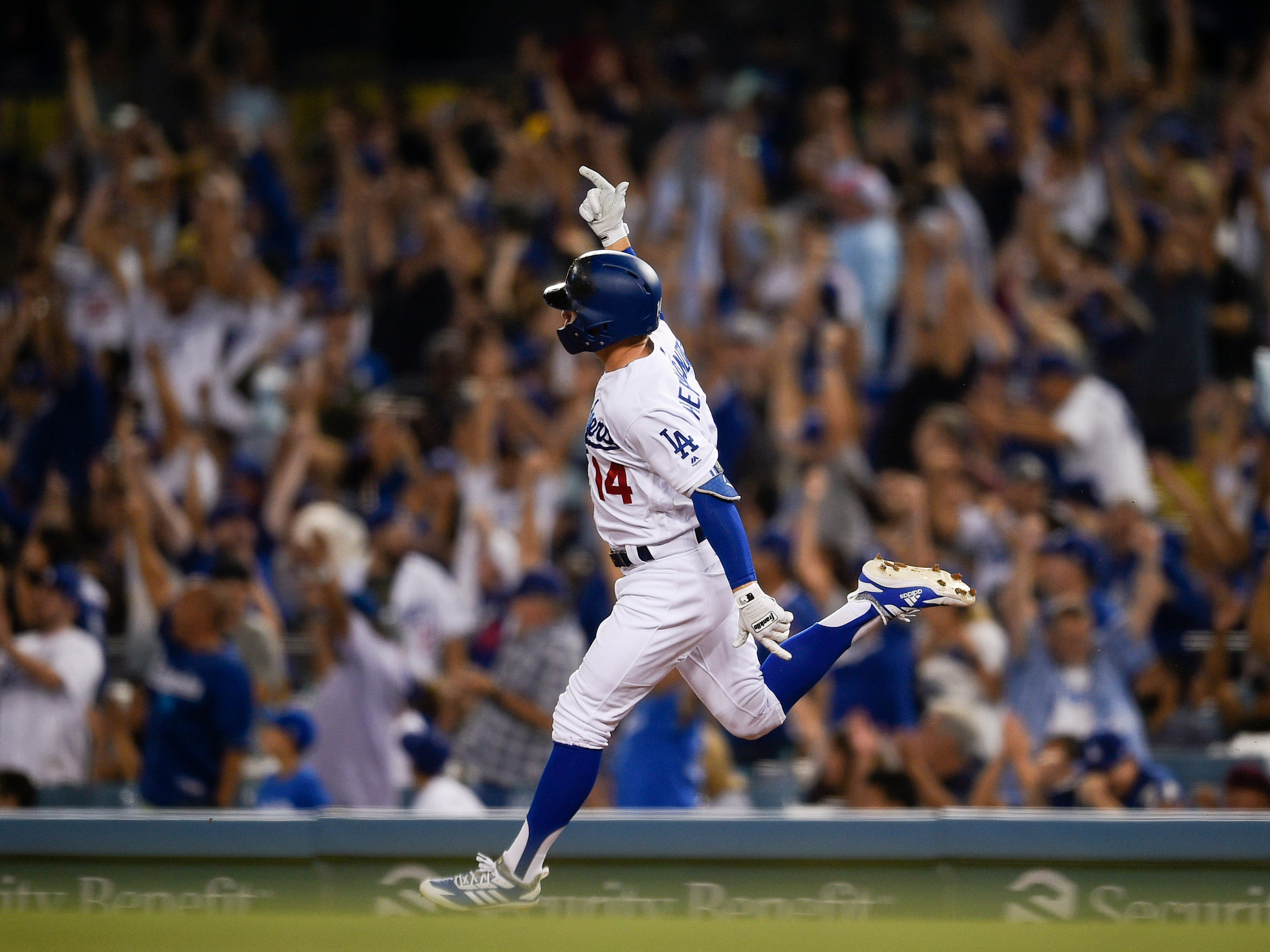 Aug 31, 2018: Los Angeles Dodgers pinch hitter Enrique Hernandez celebrates while rounding the bases after hitting the game tying solo home run during the seventh inning against the Arizona Diamondbacks at Dodger Stadium.