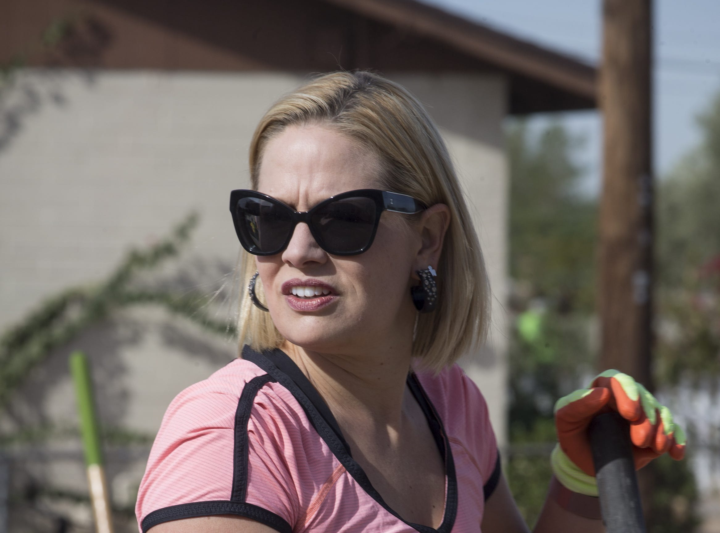 Kyrsten Sinema works on a Habitat for Humanity Neighborhood Revitalization Program project  Nov. 21, 2017, in Tempe.