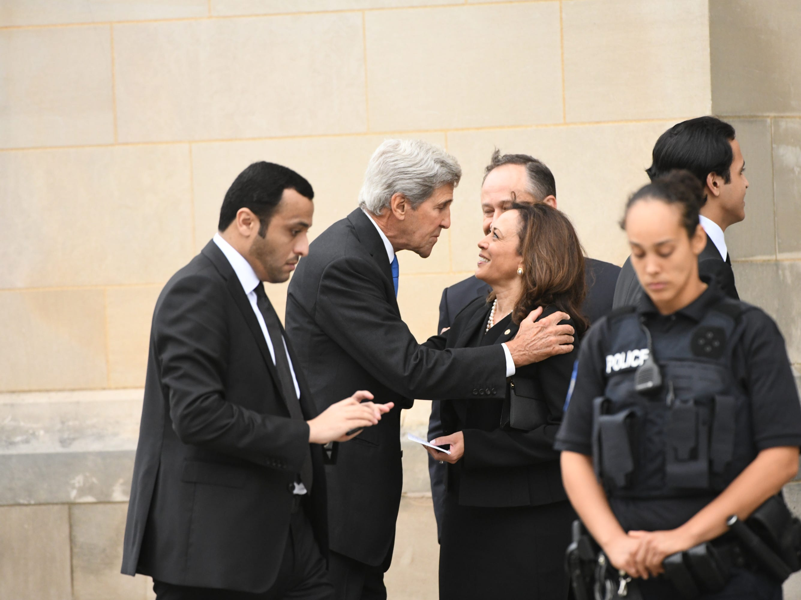 John Kerry and Kamala Harris share a moment before the National Cathedral in Washington for a memorial service for John McCain on Sept. 1, 2018. Sen. McCain on Sept. 1, 2018. Sen. McCain on Aug. 25.