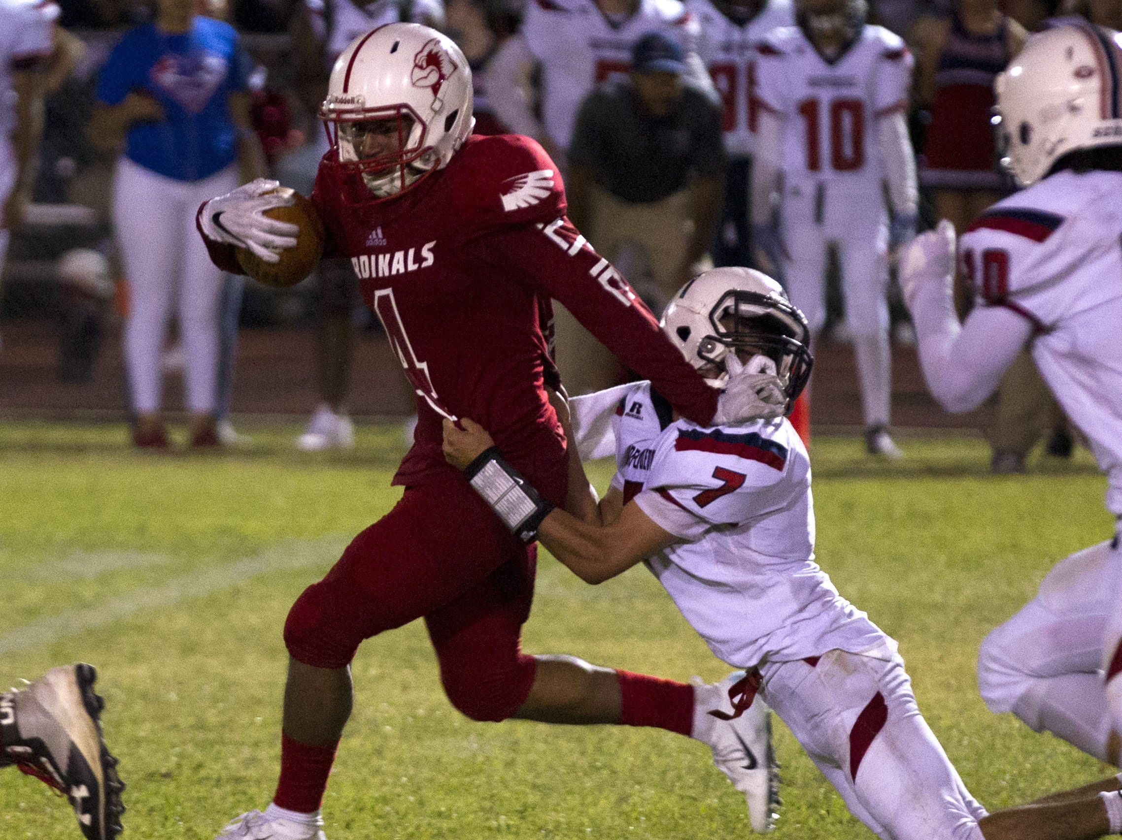Glendale's Andre Neal pushes away from Independence's  Samuel Espindola during their game in Glendale Friday, Aug. 31, 2018. #azhsfb