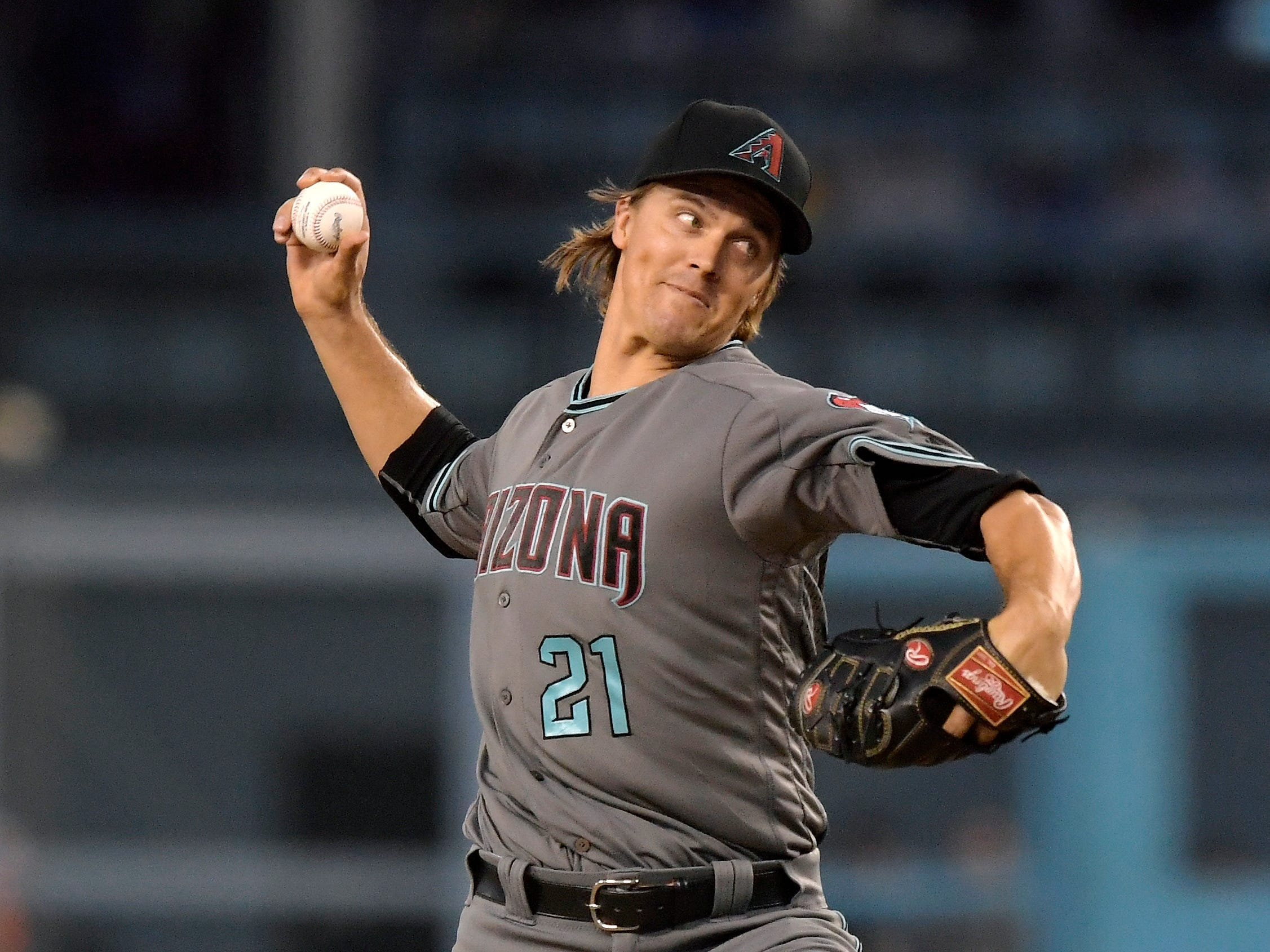 Arizona Diamondbacks starting pitcher Zack Greinke throws to the plate during the first inning of a baseball game against the Los Angeles Dodgers, Friday, Aug. 31, 2018, in Los Angeles.