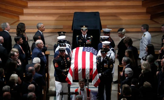 The casket of Sen. John McCain, R-Ariz., is carried at the end of a memorial service at Washington National Cathedral in Washington Sept. 1, 2018.