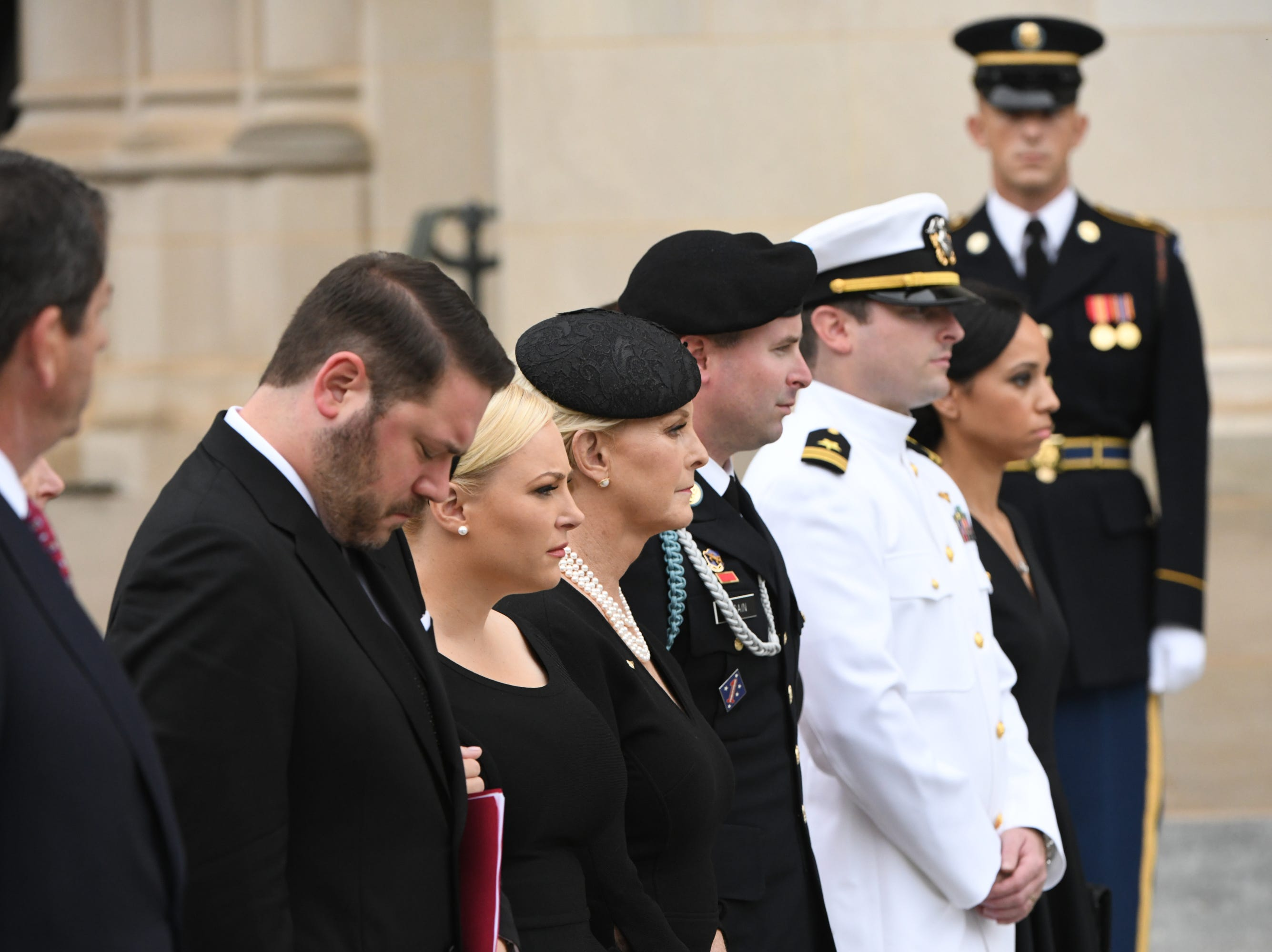 9/1/18 9:42:32 AM -- Washington, DC, U.S.A  -- Members of the McCain family watch as John McCainÕs casket is carried into the National Cathedral in Washington for a memorial service on Sept. 1, 2018. Sen. McCain died on Aug. 25. --    Photo by Jasper Colt, USA TODAY Staff