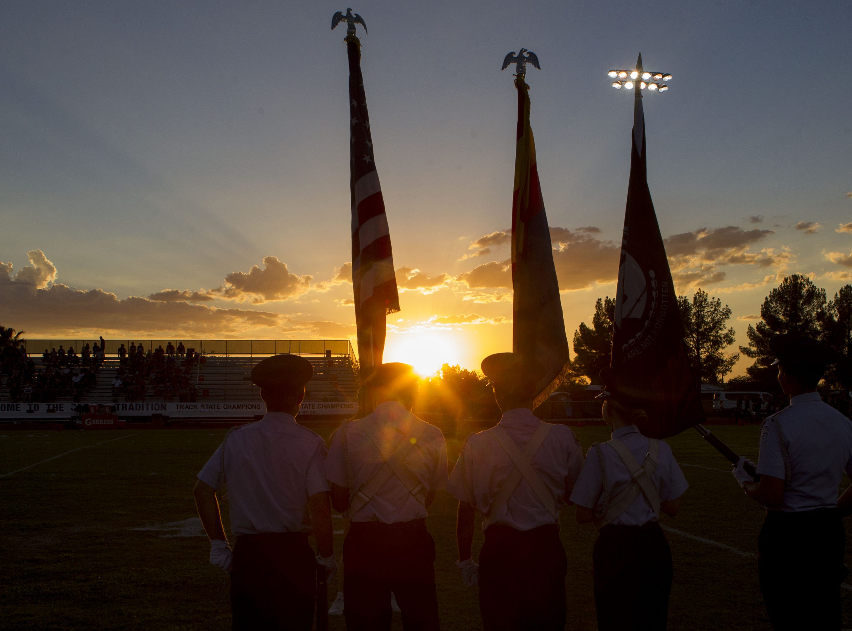 The Cactus High School Color Guard lineup before their game with Ironwood at Cactus High School in Glendale Friday, Aug. 31, 2018.