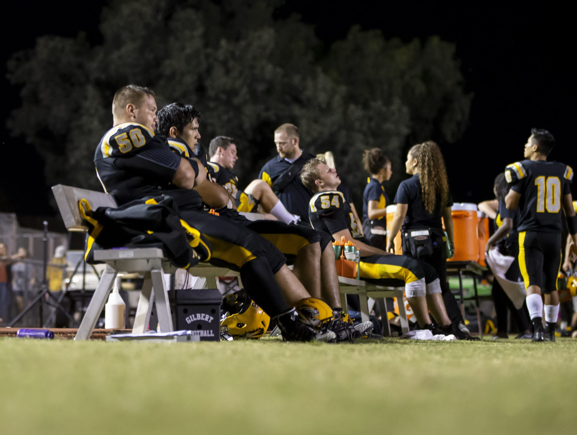 The Gilbert Tigers react to a 47-0 deficit against the Notre Dame Prep Saints at Gilbert High School on Friday, Aug. 31, 2018 in Gilbert, Arizona.