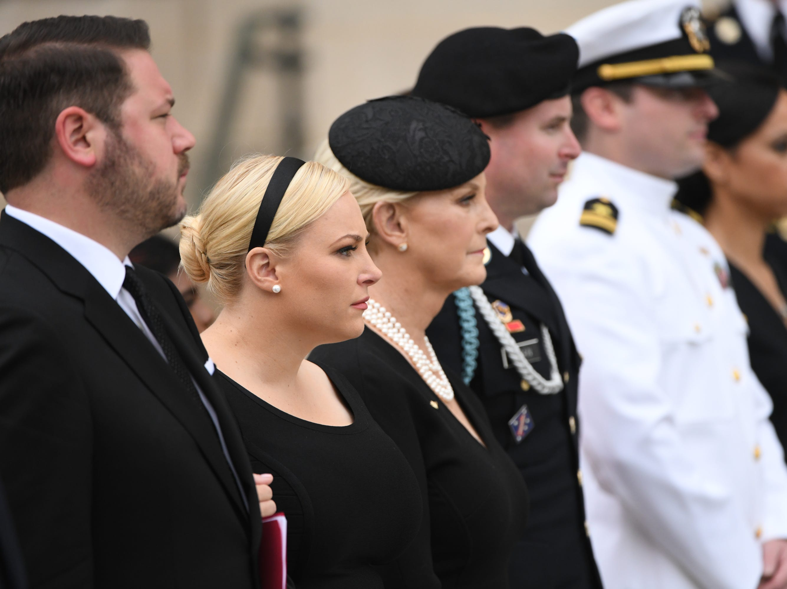 9/1/18 9:42:14 AM -- Washington, DC, U.S.A  -- Members of the McCain family watch as John McCainÕs casket is carried into the National Cathedral in Washington for a memorial service on Sept. 1, 2018. Sen. McCain died on Aug. 25. --    Photo by Jasper Colt, USA TODAY Staff