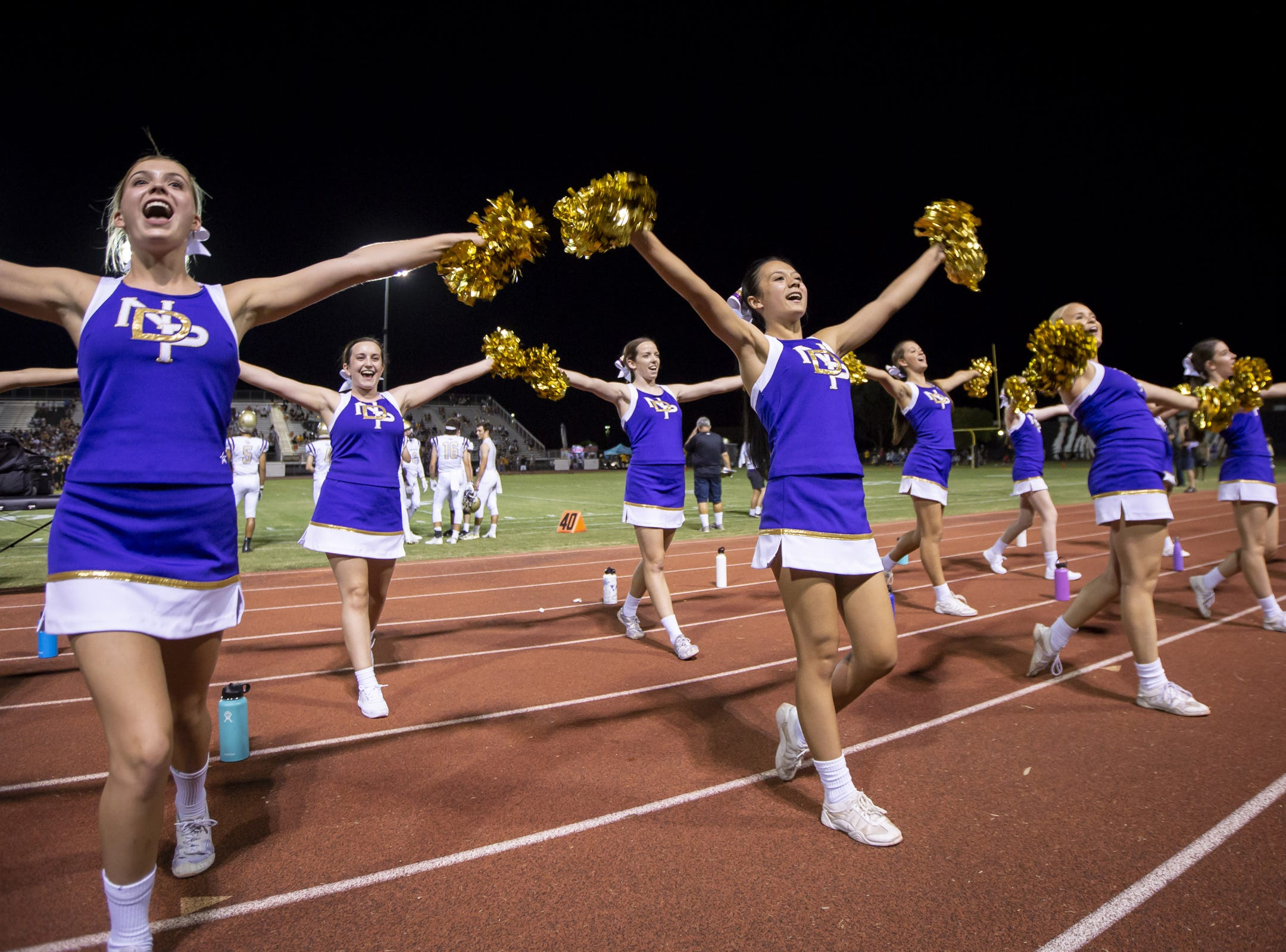Notre Dame Prep cheerleaders cheer during the game against the Gilbert Tigers at Gilbert High School on Friday, August 31, 2018 in Gilbert, Arizona.
