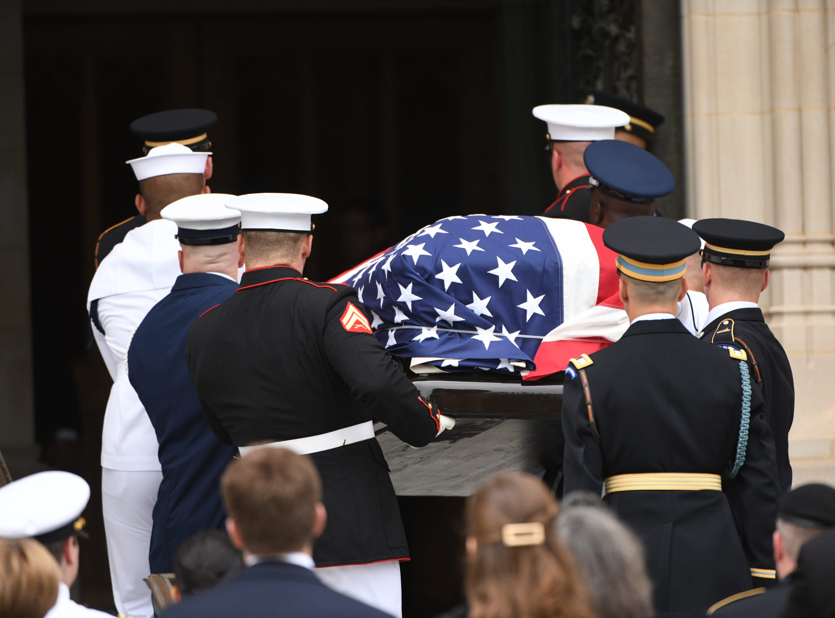 9/1/18 9:48:15 AM -- Washington, DC, U.S.A  -- Members of the McCain family watch as John McCainÕs casket is carried into the National Cathedral in Washington for a memorial service on Sept. 1, 2018. Sen. McCain died on Aug. 25. --    Photo by Jasper Colt, USA TODAY Staff