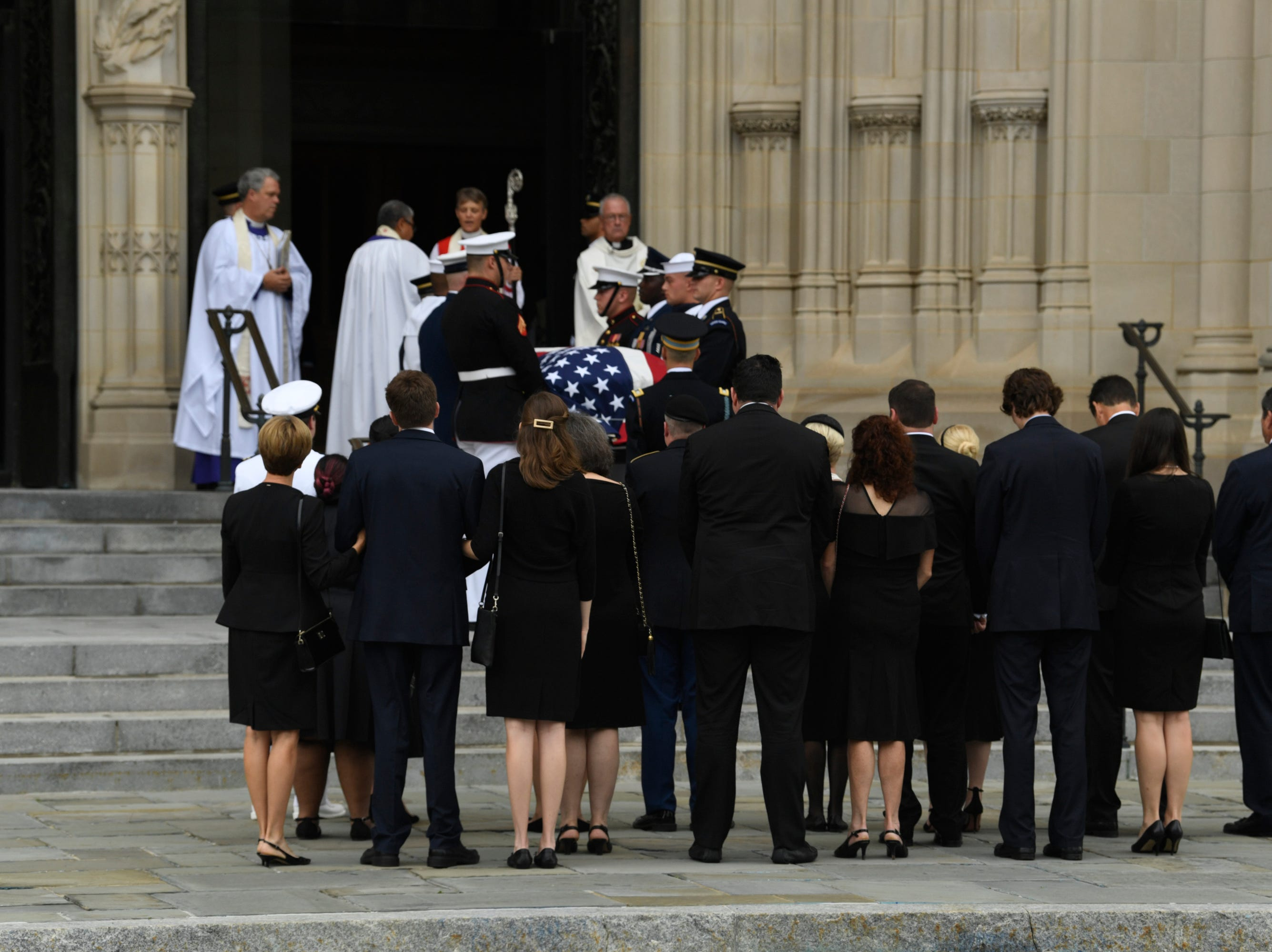 9/1/18 9:46:00 AM -- Washington, DC, U.S.A  -- Members of the McCain family watch as John McCainÕs casket is carried into the National Cathedral in Washington for a memorial service on Sept. 1, 2018. Sen. McCain died on Aug. 25. --    Photo by Jasper Colt, USA TODAY Staff