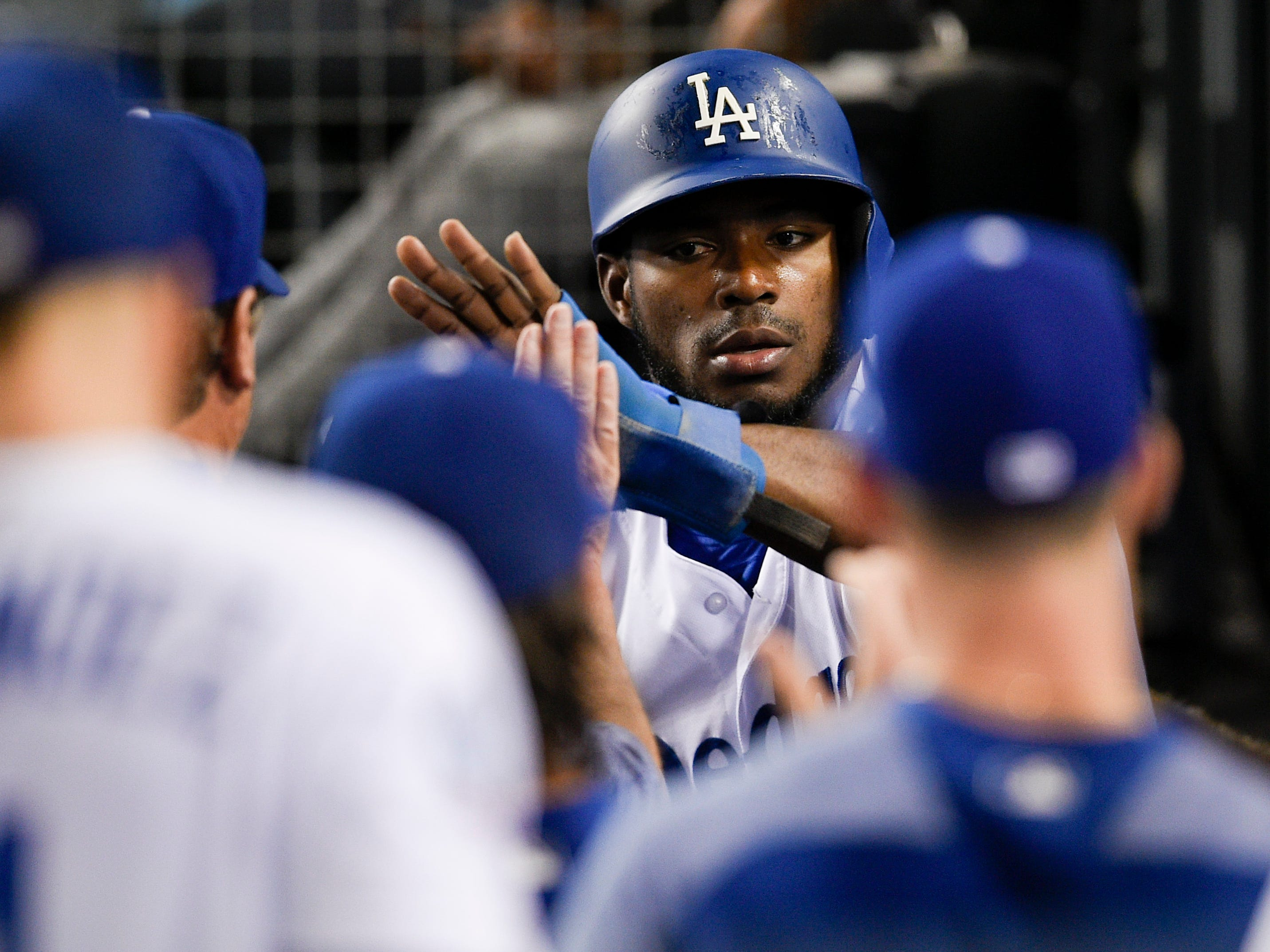 Aug 31, 2018: Los Angeles Dodgers right fielder Yasiel Puig (66) celebrates with the dugout after scoring off an RBI single by left fielder Joc Pederson (not pictured) during the third inning against the Arizona Diamondbacks at Dodger Stadium.