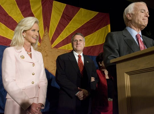Republican Jon Kyl (center) celebrates a near victory with John McCain (right) and his wife as the election results come in, at the Hilton in Scottsdale. Photo by Catherine J. Jun/Arizona Republic Staff Photographer