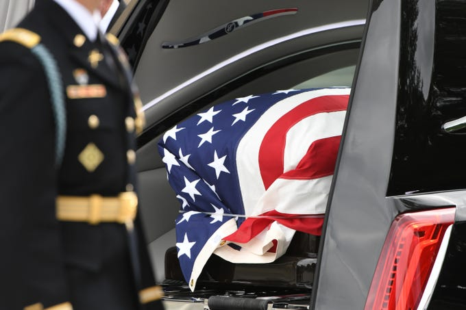 9/1/18 12:41:26 PM -- Washington, DC, U.S.A  -- The flag-draped casket bearing John McCain is prepared to leave the National Cathedral in Washington on Sept. 1, 2018. Sen. McCain died on Aug. 25. --    Photo by Jasper Colt, USA TODAY Staff