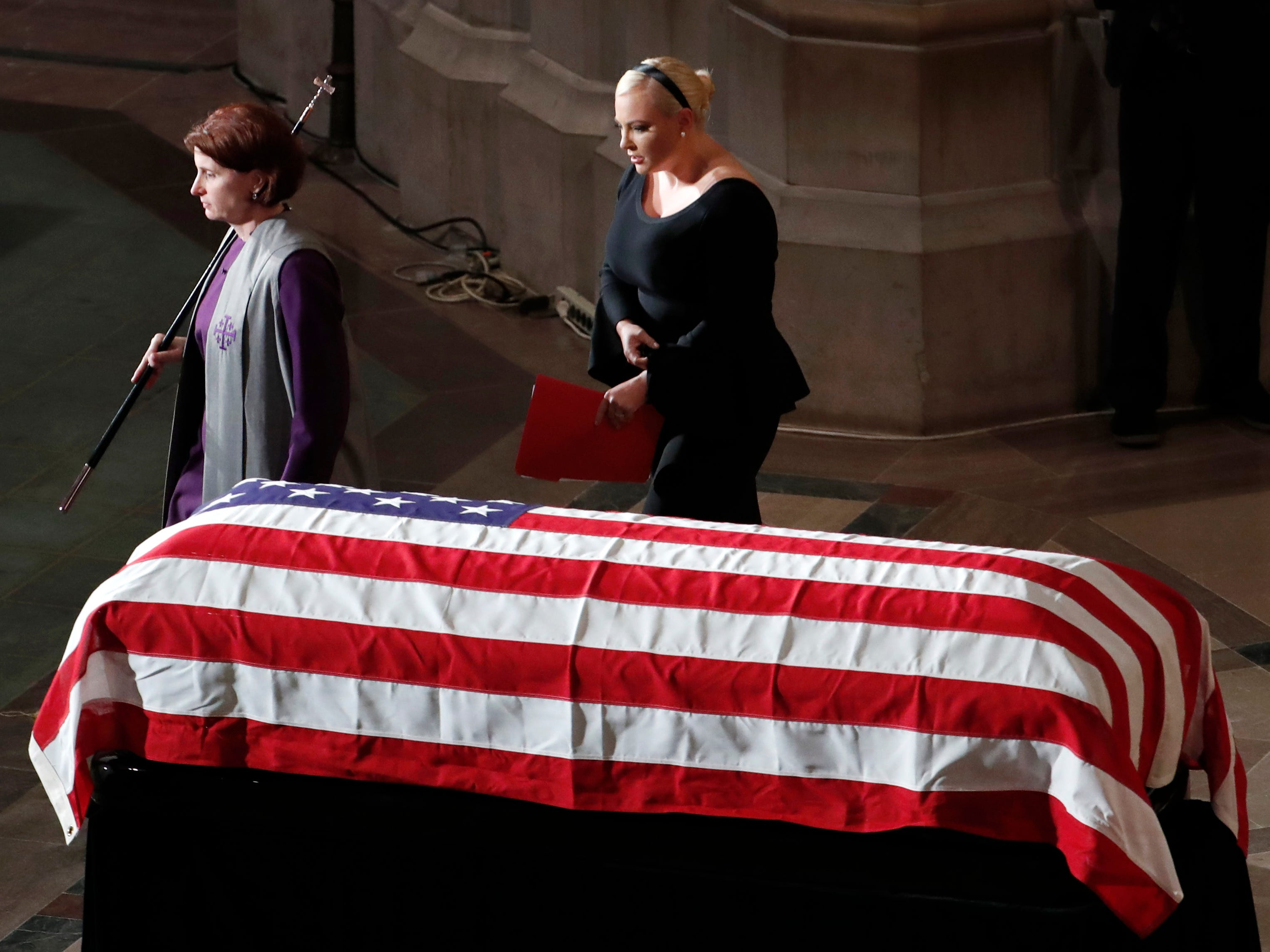 Meghan McCain walks from the podium after speaking at a memorial service for her father, Sen. John McCain, R-Ariz., at Washington National Cathedral in Washington, Saturday, Sept. 1, 2018. McCain died Aug. 25, from brain cancer at age 81. (AP Photo/Pablo Martinez Monsivais)