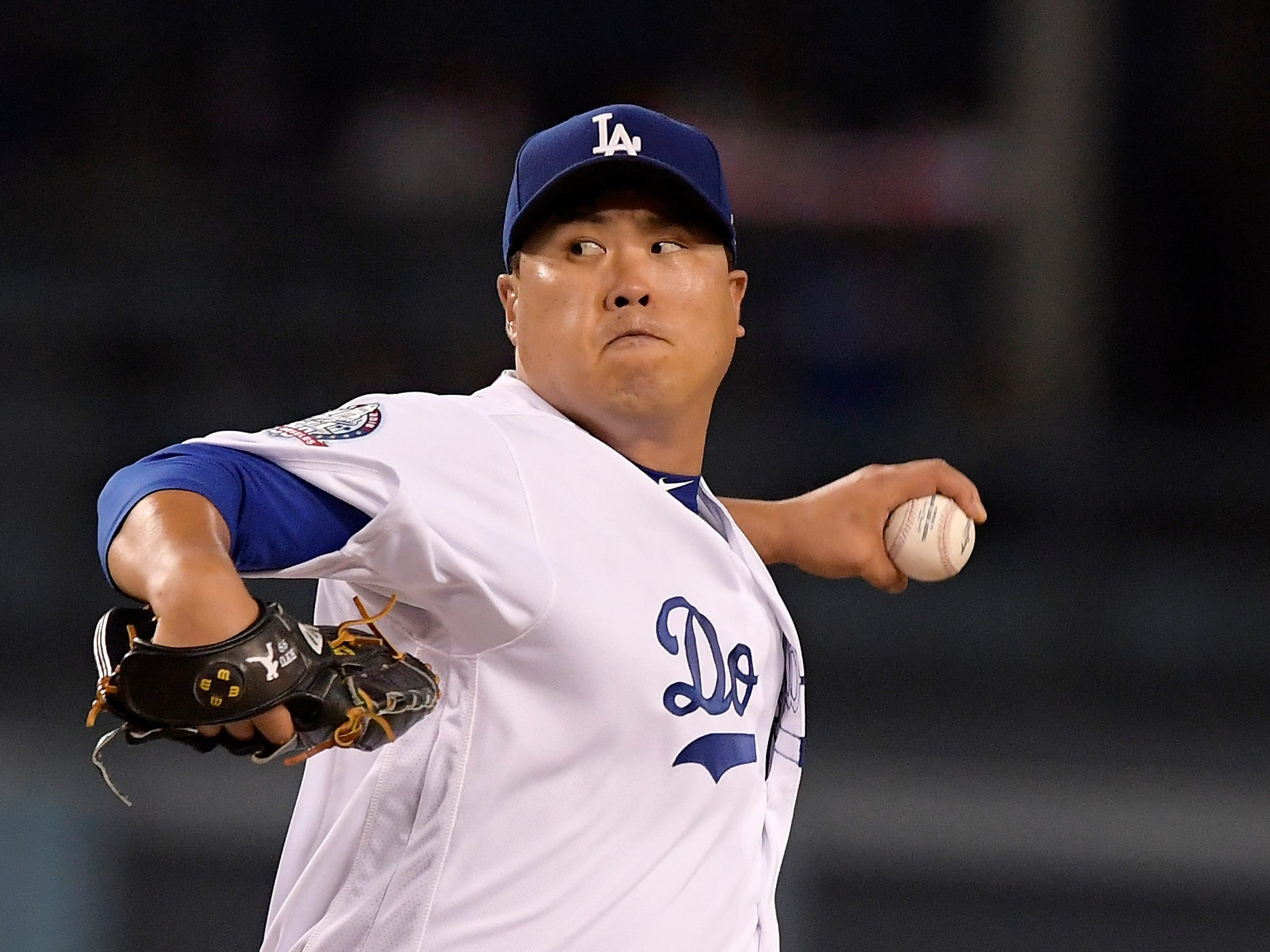 Los Angeles Dodgers starting pitcher Hyun-Jin Ryu, of South Korea, throws to the plate during the second inning of a baseball game against the Arizona Diamondbacks, Friday, Aug. 31, 2018, in Los Angeles.
