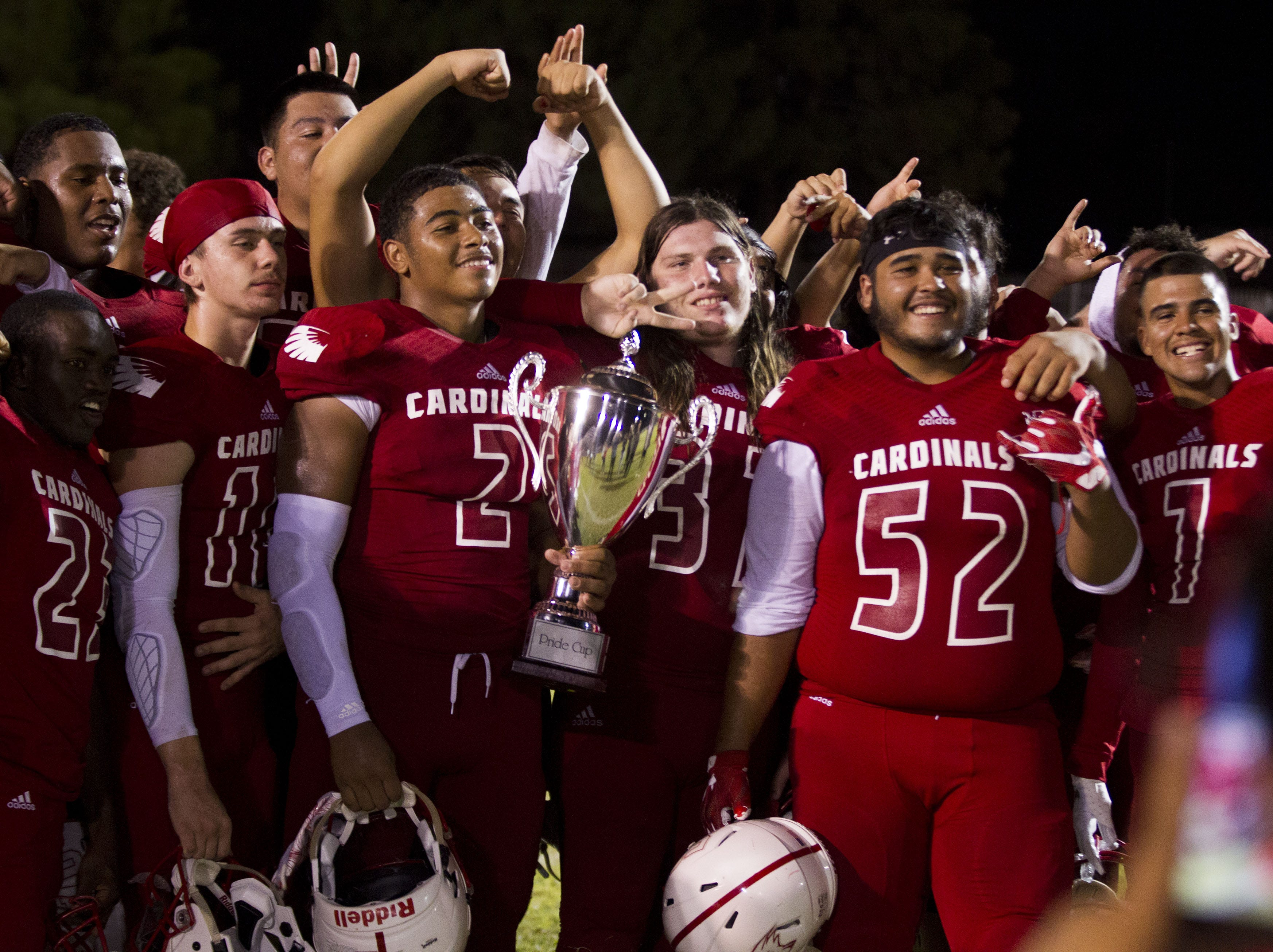 Glendale players celebrate winning the Pride Cup over  Independence in Glendale Friday, Aug. 31, 2018. #azhsfb