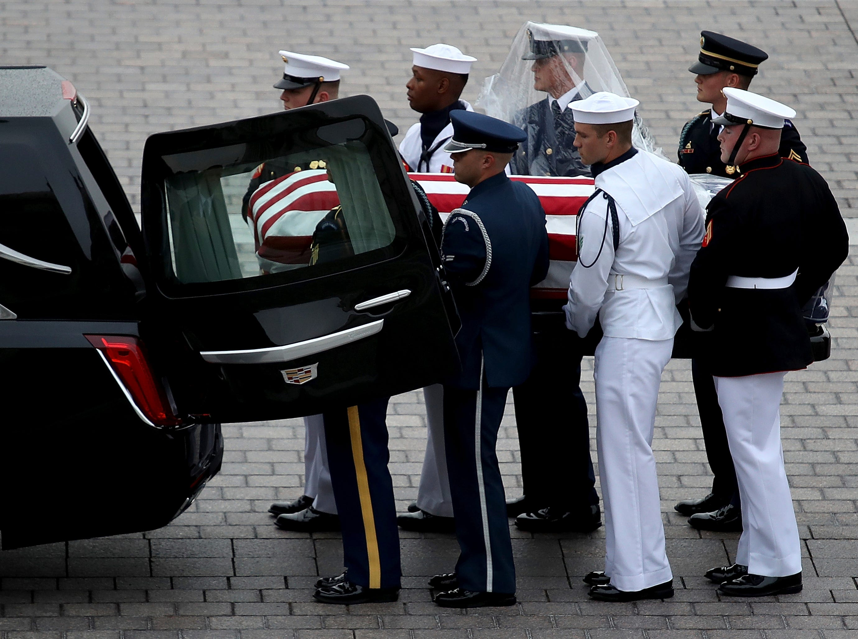 A military honor guard team places the casket of Sen. John McCain, R-Ariz., into a waiting hearse at the U.S. Capitol, Saturday, Sept. 1, 2018 in Washington.  (Win McNamee/Pool photo via AP)