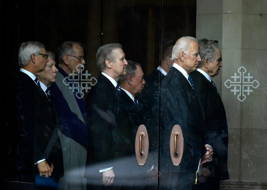 Former Vice President Joe Biden, second from right, and actor Warren Beatty, right, wait to escort the casket of Sen. John McCain, R-Ariz., at Washington National Cathedral in Washington, Saturday, Sept. 1, 2018, for a memorial service. McCain died Aug. 25 from brain cancer at age 81. (AP Photo/Susan Walsh)