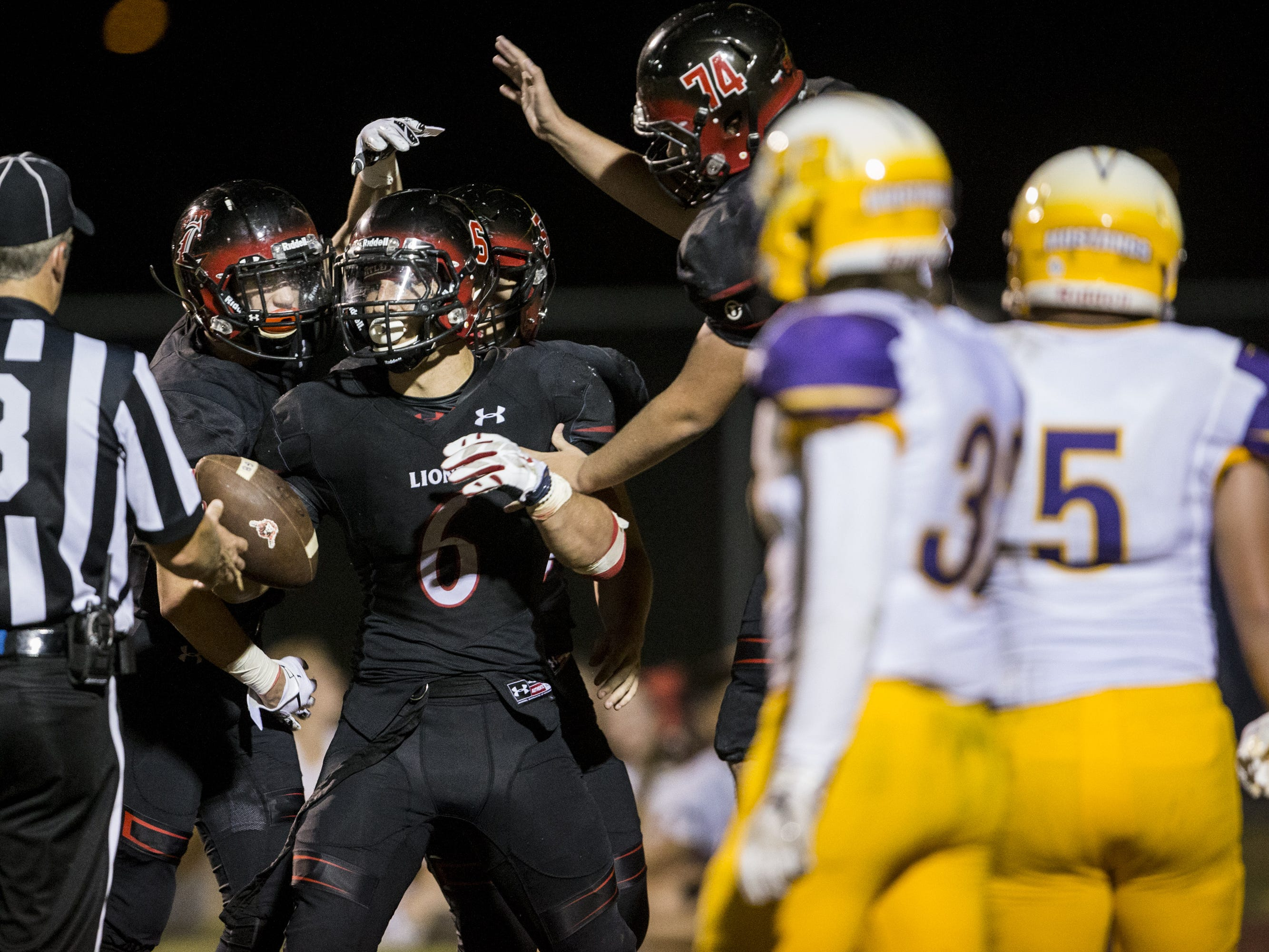 Liberty's Jett Kinsch celebrates after rushing for a touchdown against Sunrise Mountain in the 3rd quarter on Friday, Aug. 31, 2018, at Liberty High School in Peoria, Ariz.  #azhsfb