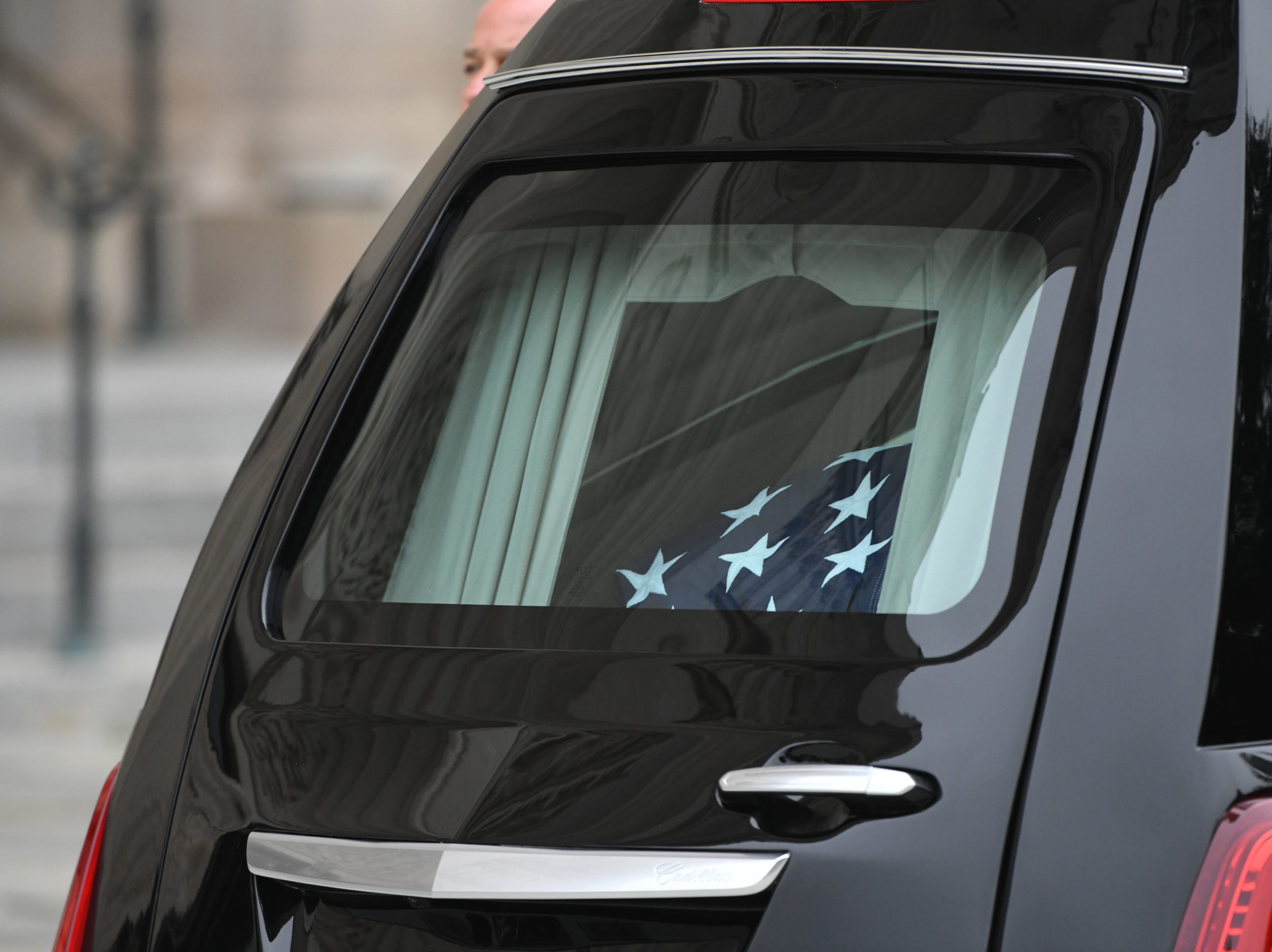 9/1/18 9:28:17 AM -- Washington, DC, U.S.A  -- The flag-draped casket bearing John McCain arrives into the National Cathedral in Washington for a memorial service on Sept. 1, 2018. Sen. McCain died on Aug. 25. --    Photo by Jasper Colt, USA TODAY Staff