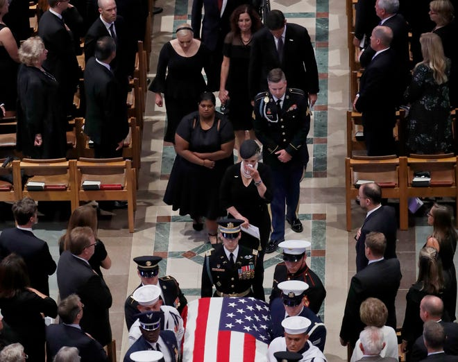 The family of Sen. John McCain, R-Ariz., follow as the casket is carried during the recessional at the end of a memorial service at Washington National Cathedral in Washington, Saturday, Sept. 1, 2018. McCain died Aug. 25, from brain cancer at age 81. (AP Photo/Pablo Martinez Monsivais)