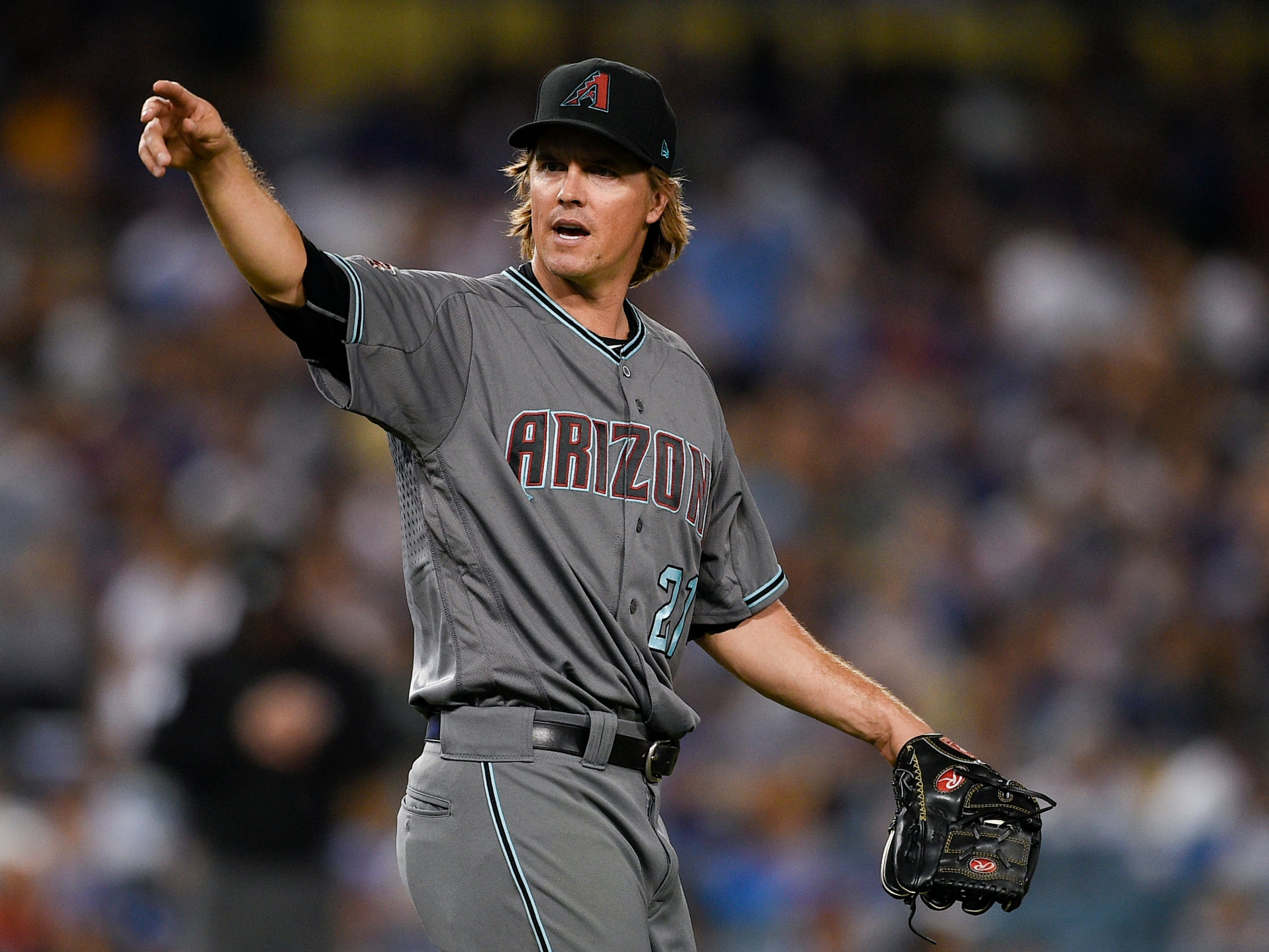 Aug 31, 2018: Arizona Diamondbacks starting pitcher Zack Greinke (21) reacts after hitting Los Angeles Dodgers third baseman Justin Turner (not pictured) on a pitch during the fifth inning at Dodger Stadium.